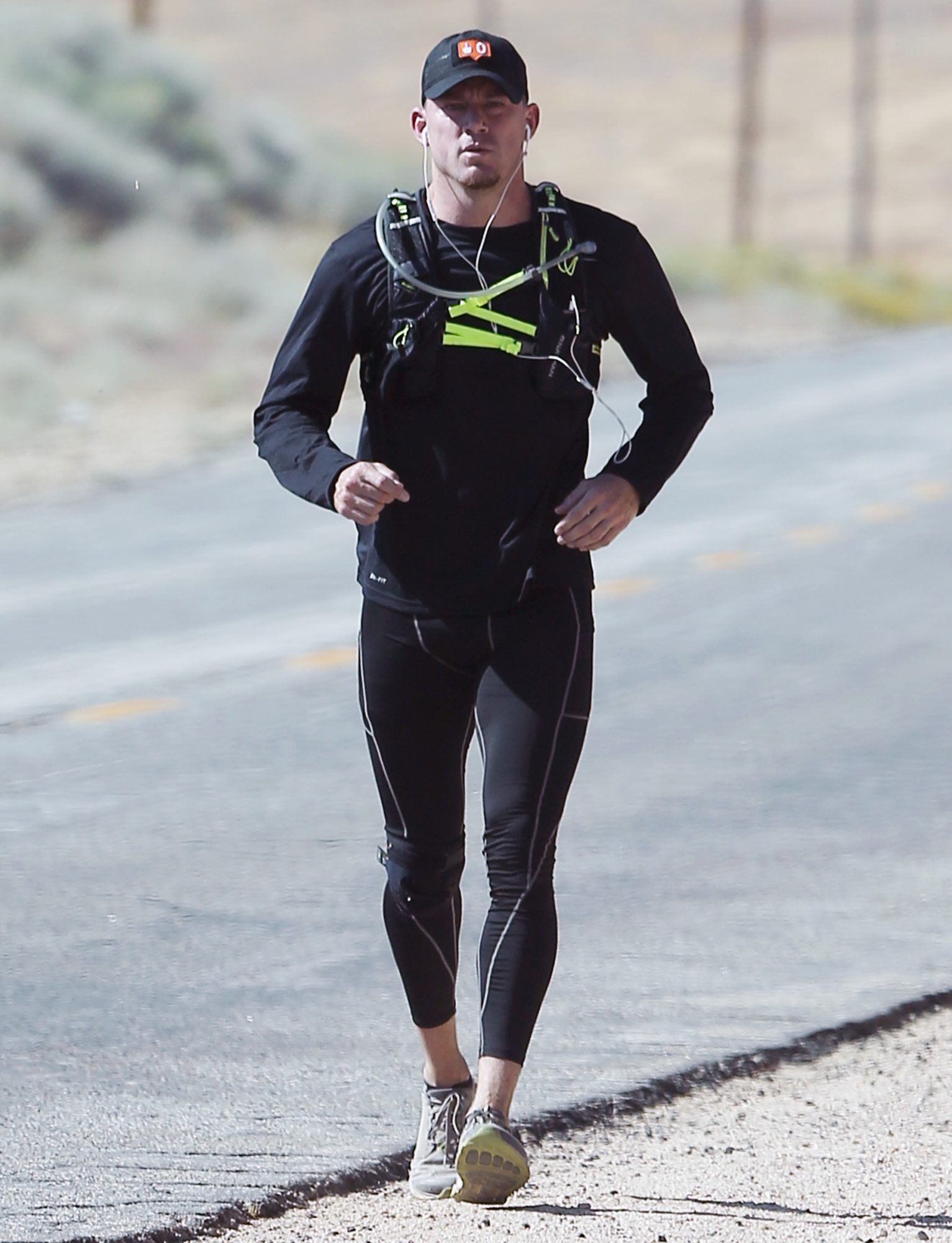 Fitness buff Channing Tatum wears tight leggings for a solo run in Los Angeles, California.
