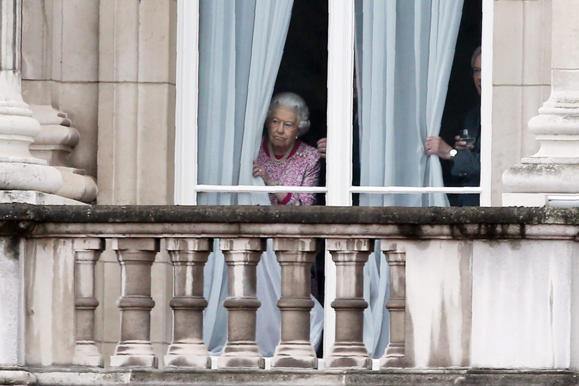 Queen Elizabeth II looks out from Buckingham Palace