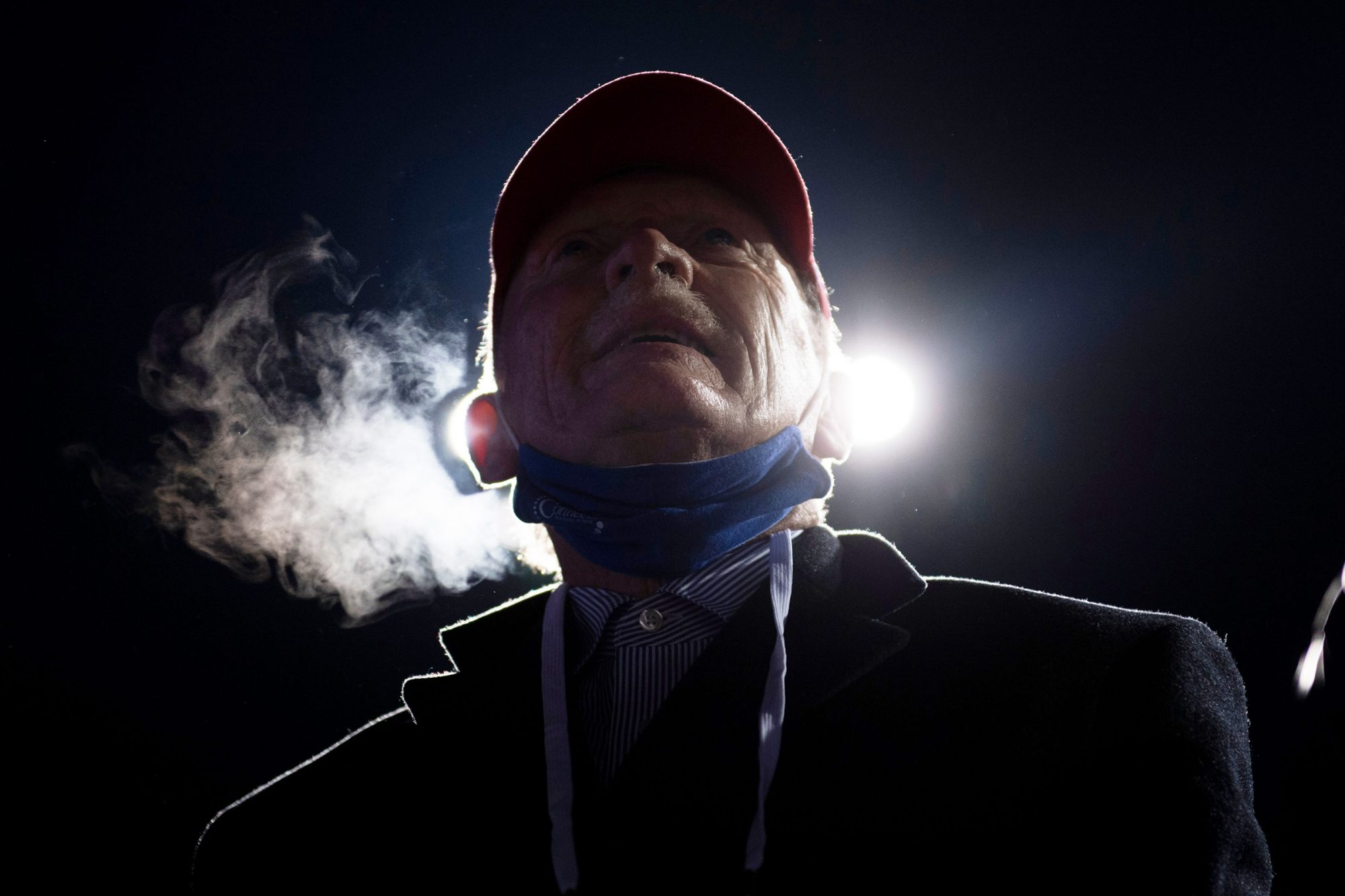 People watch as President Donald Trump speaks during a Make America Great Again rally at Eppley Airfield on October 27, 2020