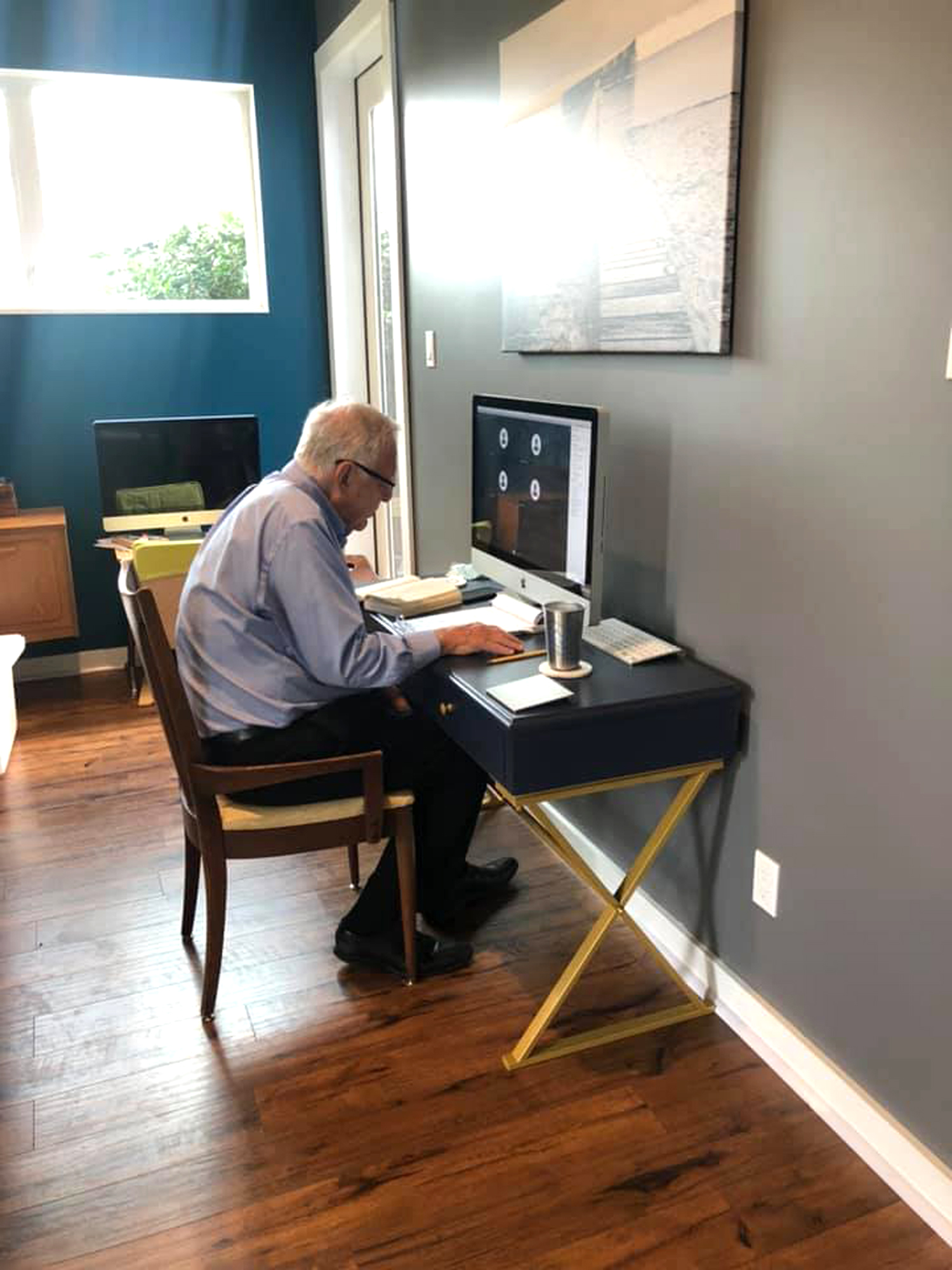 Charles Krohn, a professor of English at The University of St. Thomas for 50-plus years, as he navigated remote learning
