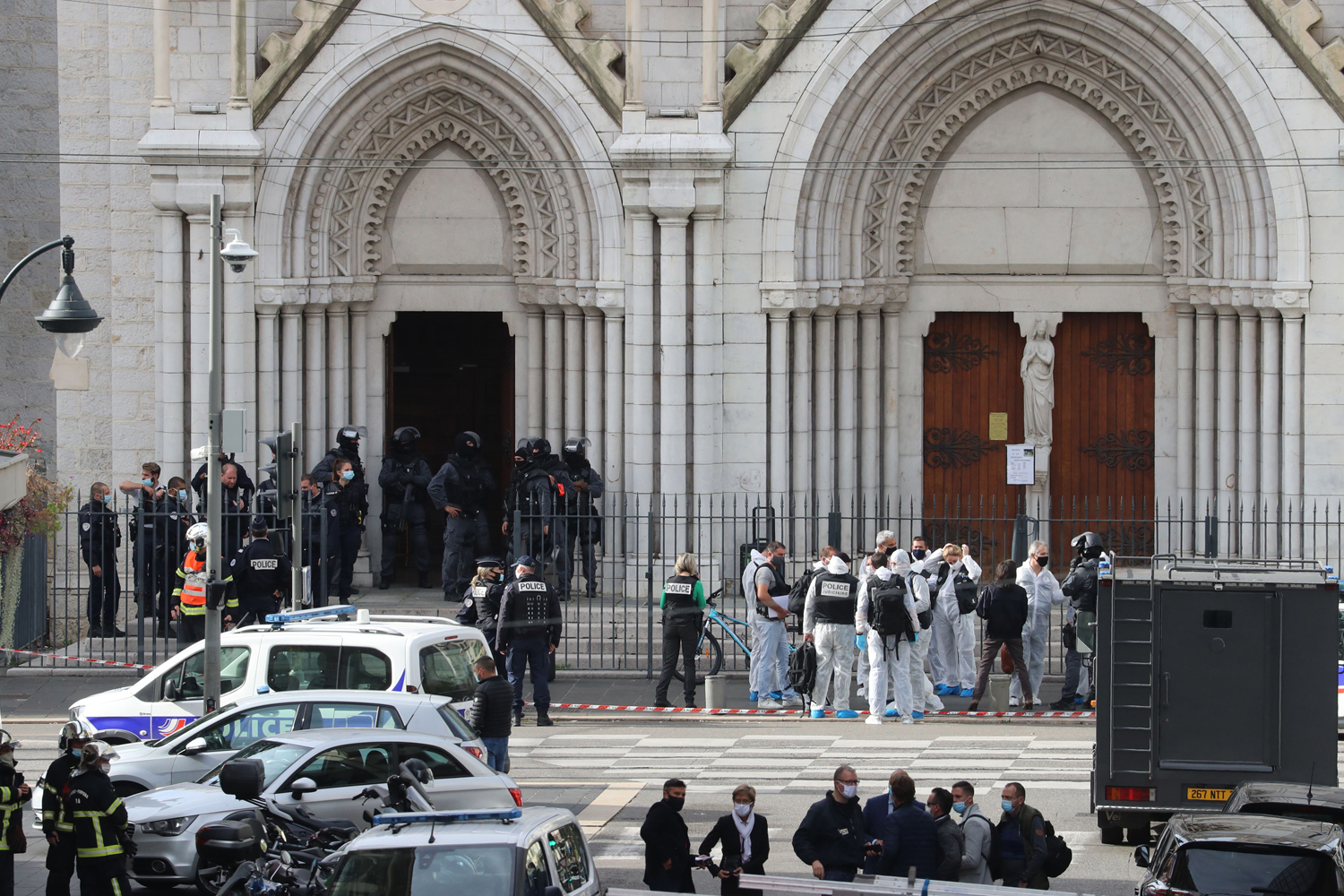 French members of the elite tactical police unit RAID enter to search the Basilica of Notre-Dame de Nice