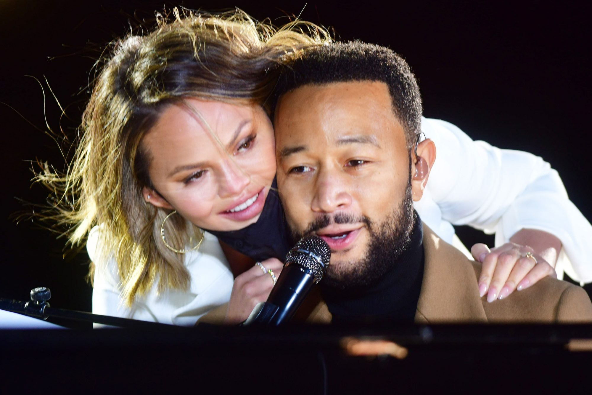 John Legend is joined onstage by his wife, Chrissy Teigen, while performing before Democratic vice presidential nominee Sen. Kamala Harris (D-CA) speaks at a drive-in election eve rally on November 2, 2020 in Philadelphia