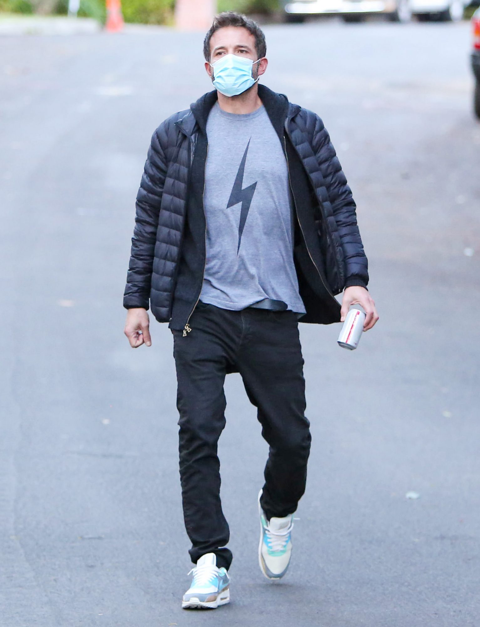 Ben Affleck is seen wearing a jacket and Nike sneakers
