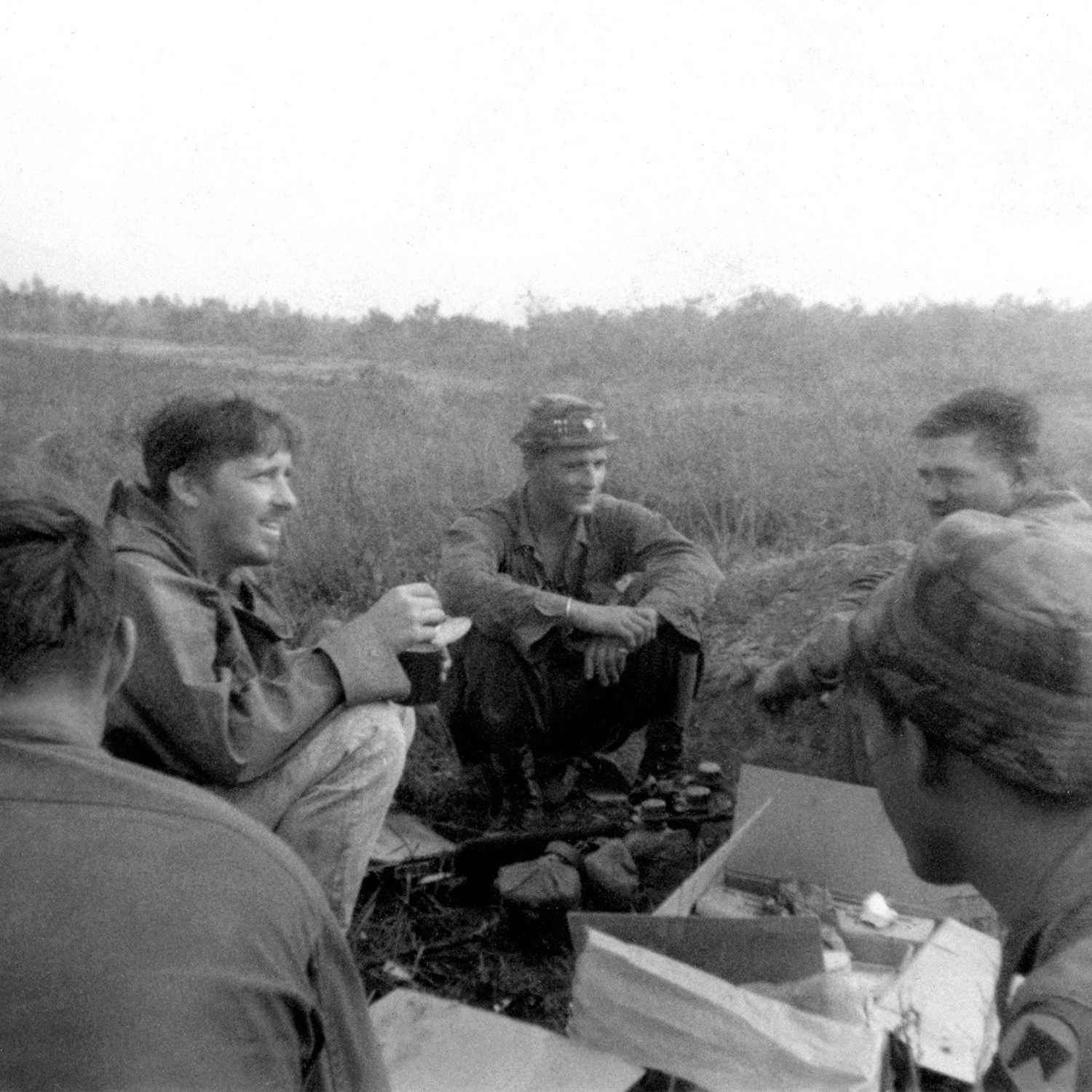 John 'Chick' Donohue (second from left) catching up with his friend Sgt. Rick Duggan (third from left) in Vietnam