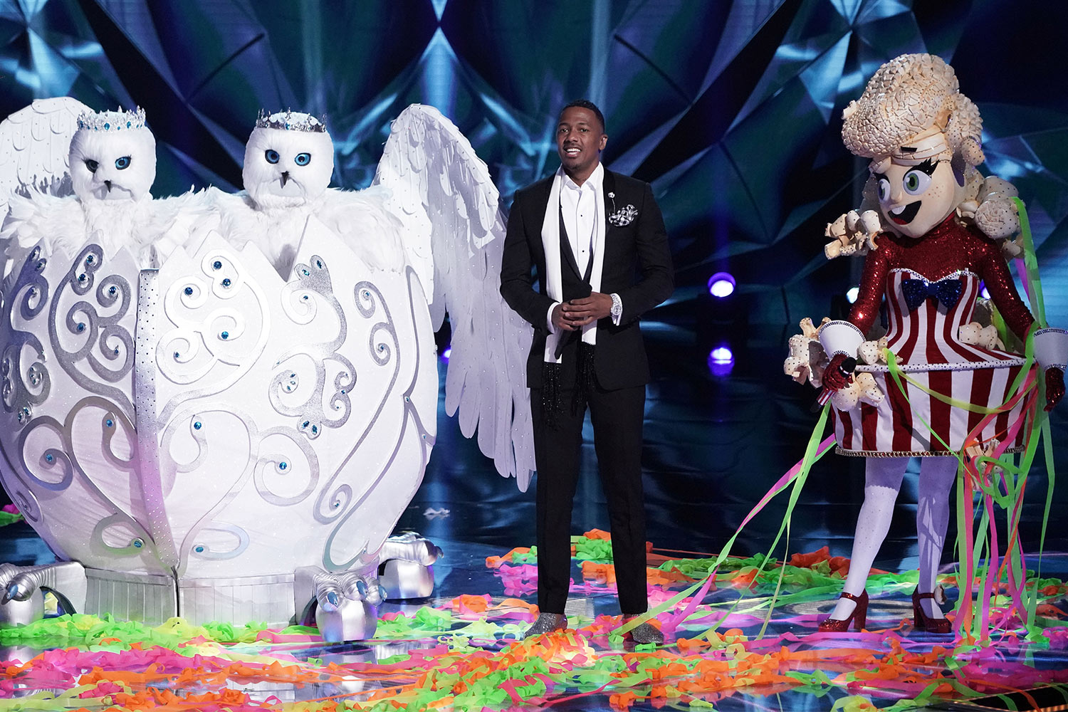 Snow Owls and Popcorn on stage with host Nick Cannon.