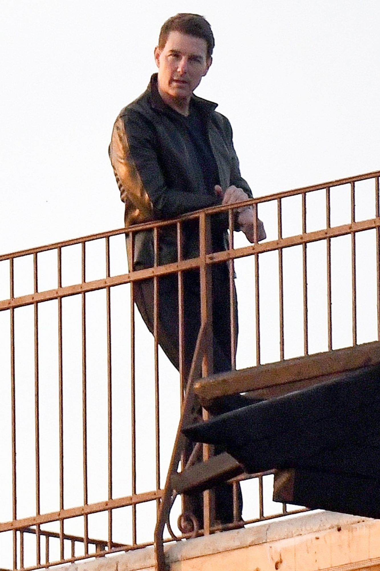 Tom Cruise and Rebecca Fergusson filming a scene for Mission Impossible 7 on a rooftop in Venice