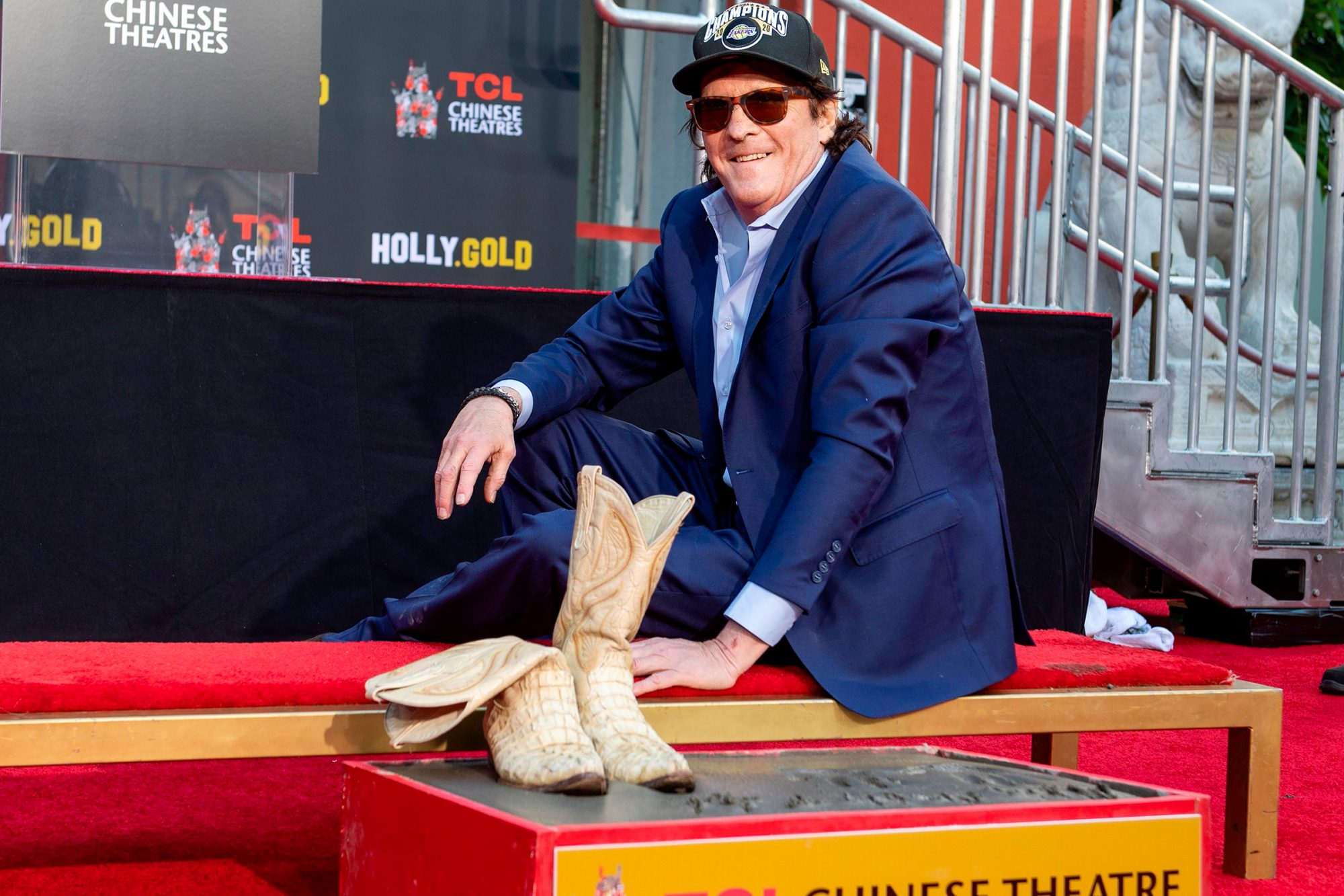 Michael Madsen places his boots in the cement during his Hand and Footprint Ceremony at TCL Chinese Theatre on November 16, 2020