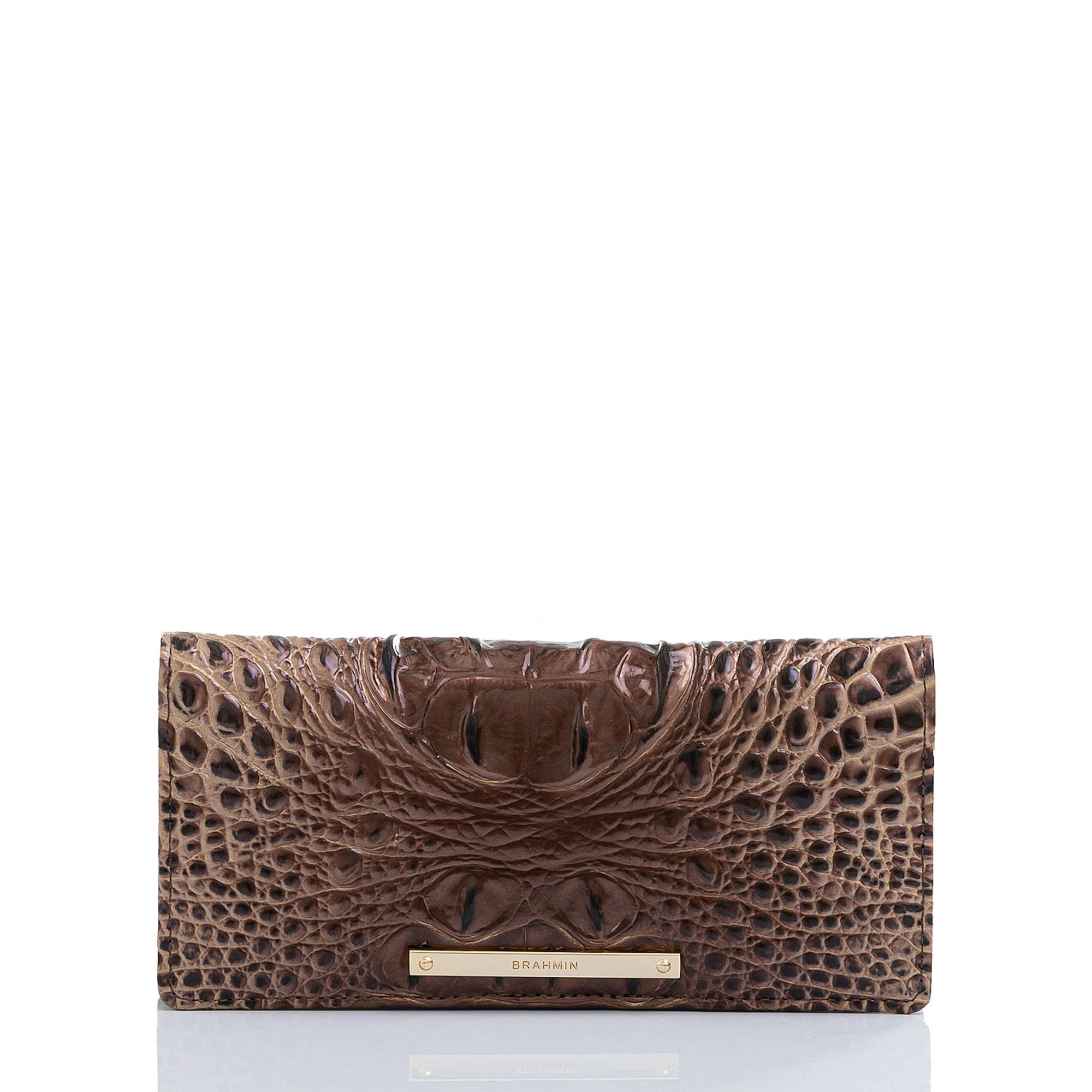 """Sarah Ball, Market Editor:I always find myself wishing I had a nice wallet, but never seem to buy one for myself, so I'm putting this mocha leather croc-embossed beauty on my list this year. It's thin and offers a ton of convenient storage and the color is so rich looking and will go with everything.                             Buy it! Brahmin """"Ady"""" Wallet, $125; brahmin.com"""