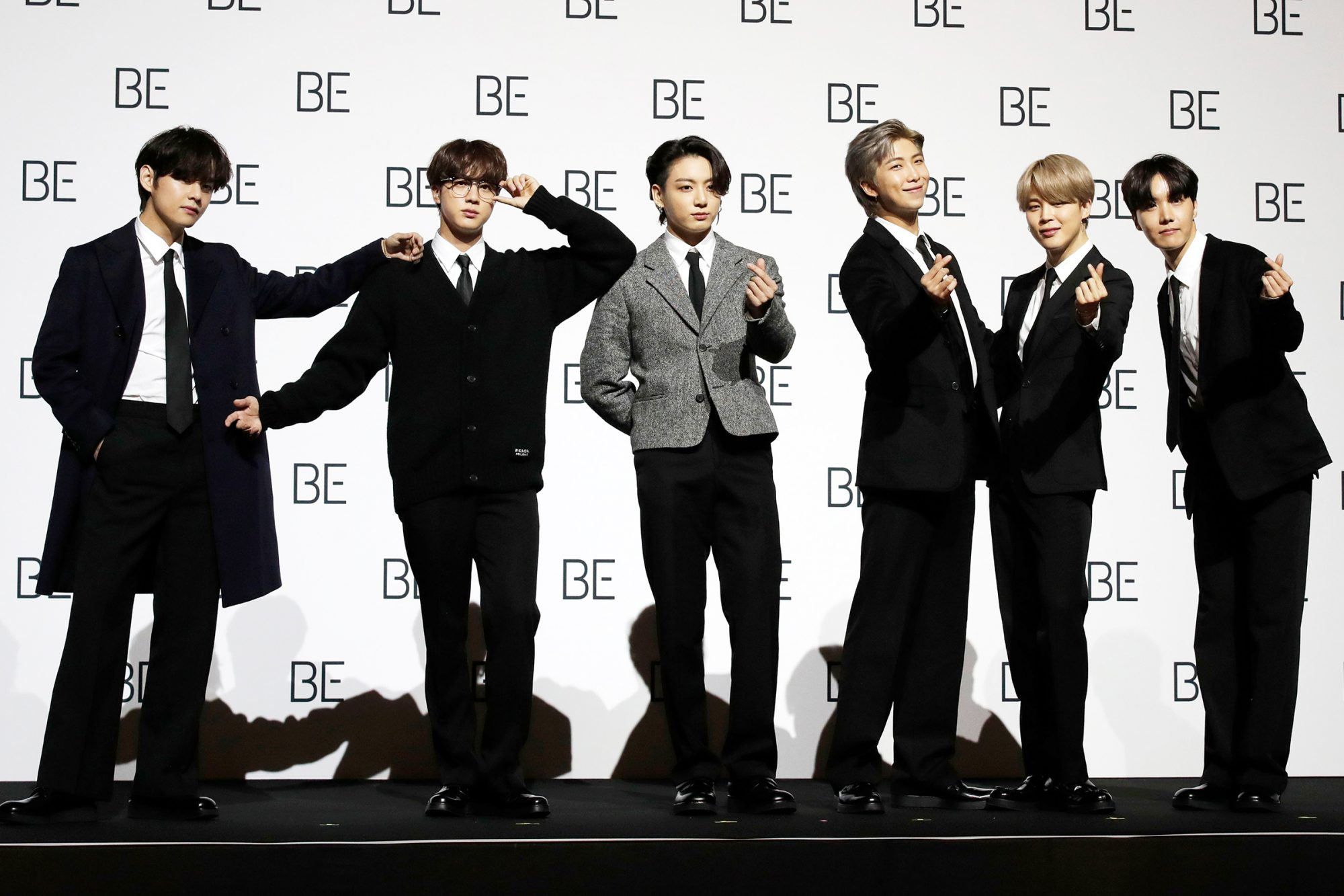 "Members of South Korean K-pop band BTS pose for photographers during a press conference to introduce their new album ""BE"" in Seoul, South Korea"