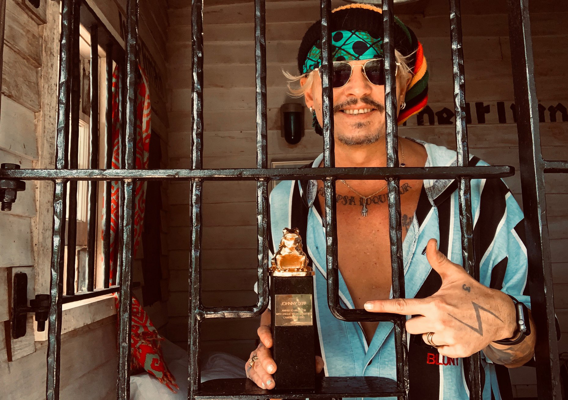 Johnny Depp accepts Camerimage Festival from behind bars in the Bahamas