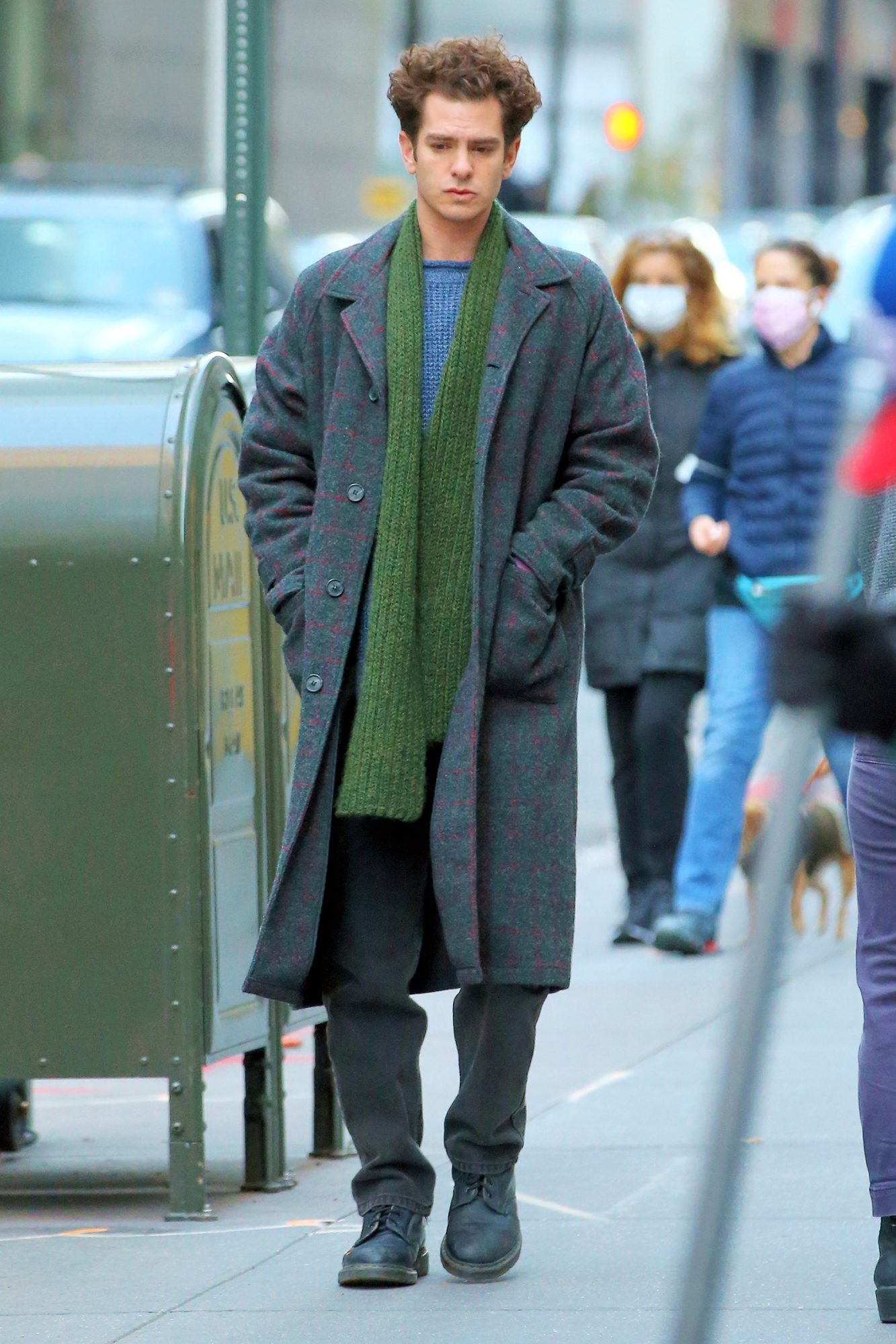 Andrew Garfield makes a call from a vintage phone booth filming 'Tick Tick Boom' in Midtown in New York City.
