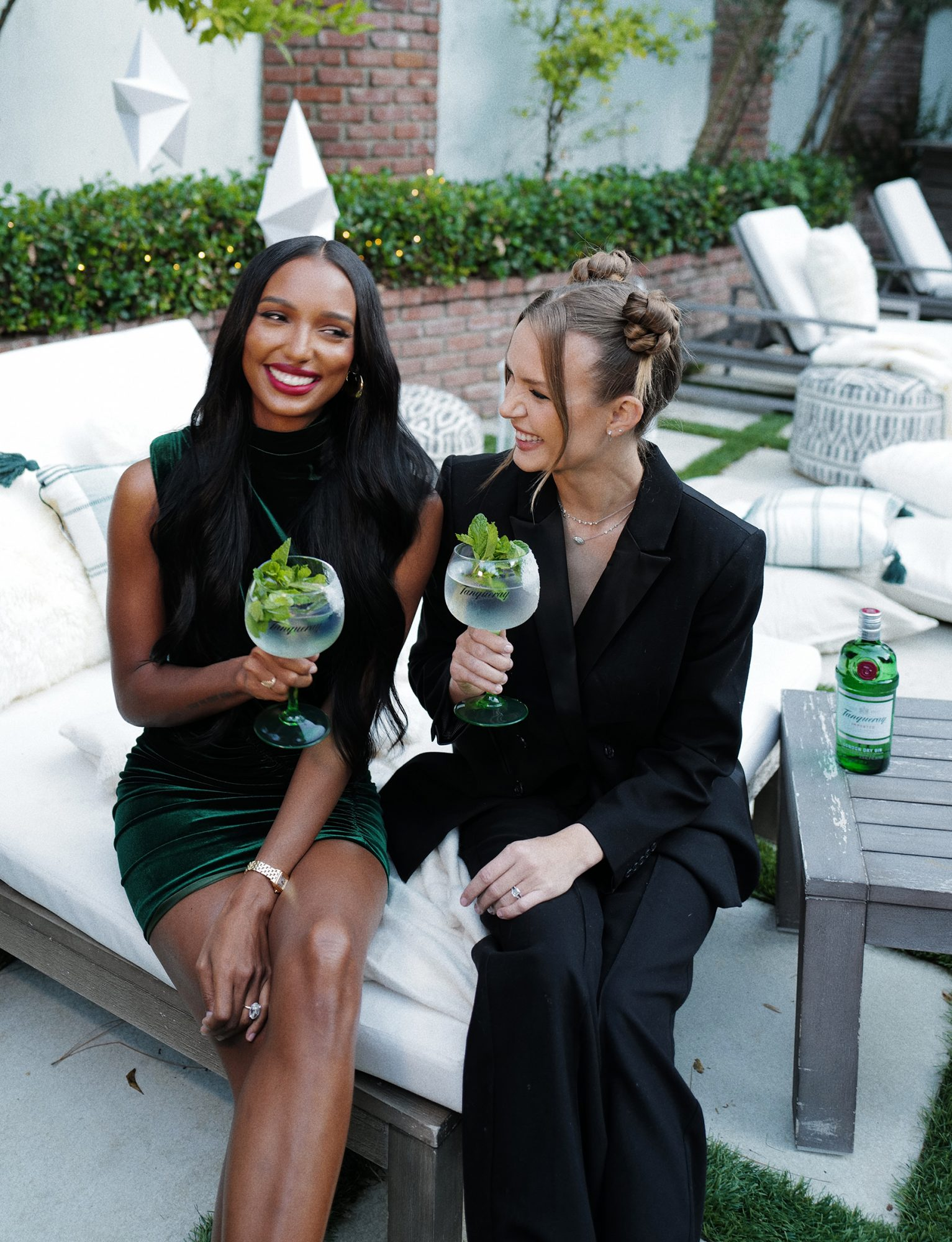 Model best friends Josephine Skriver and Jasmine Tookes get in the holiday spirit with Tanqueray.