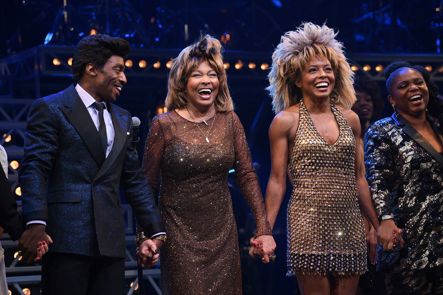 """Daniel J. Watts, Tina Turner, Adrienne Warren. Singer Tina Turner, center, takes a bow during the curtain call with actors Daniel J. Watts, left, and Adrienne Warren on the opening night of """"Tina The Tina Turner Musical"""""""