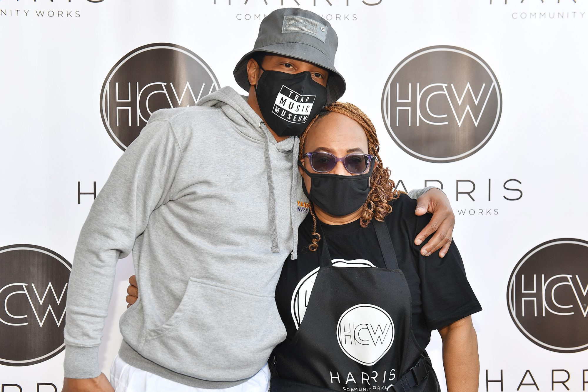 T.I. poses with his mother Violeta Morgan during Harris Community Works 15th Annual Turkey Giveaway at Jackson Memorial Baptist Church on November 24, 2020 in Atlanta