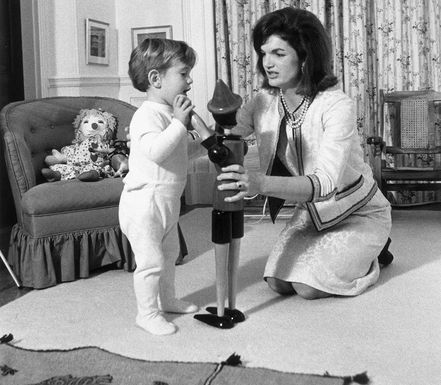 From left: John F. Kennedy Jr. and former First Lady Jacqueline Kennedy in the White House in November 1962