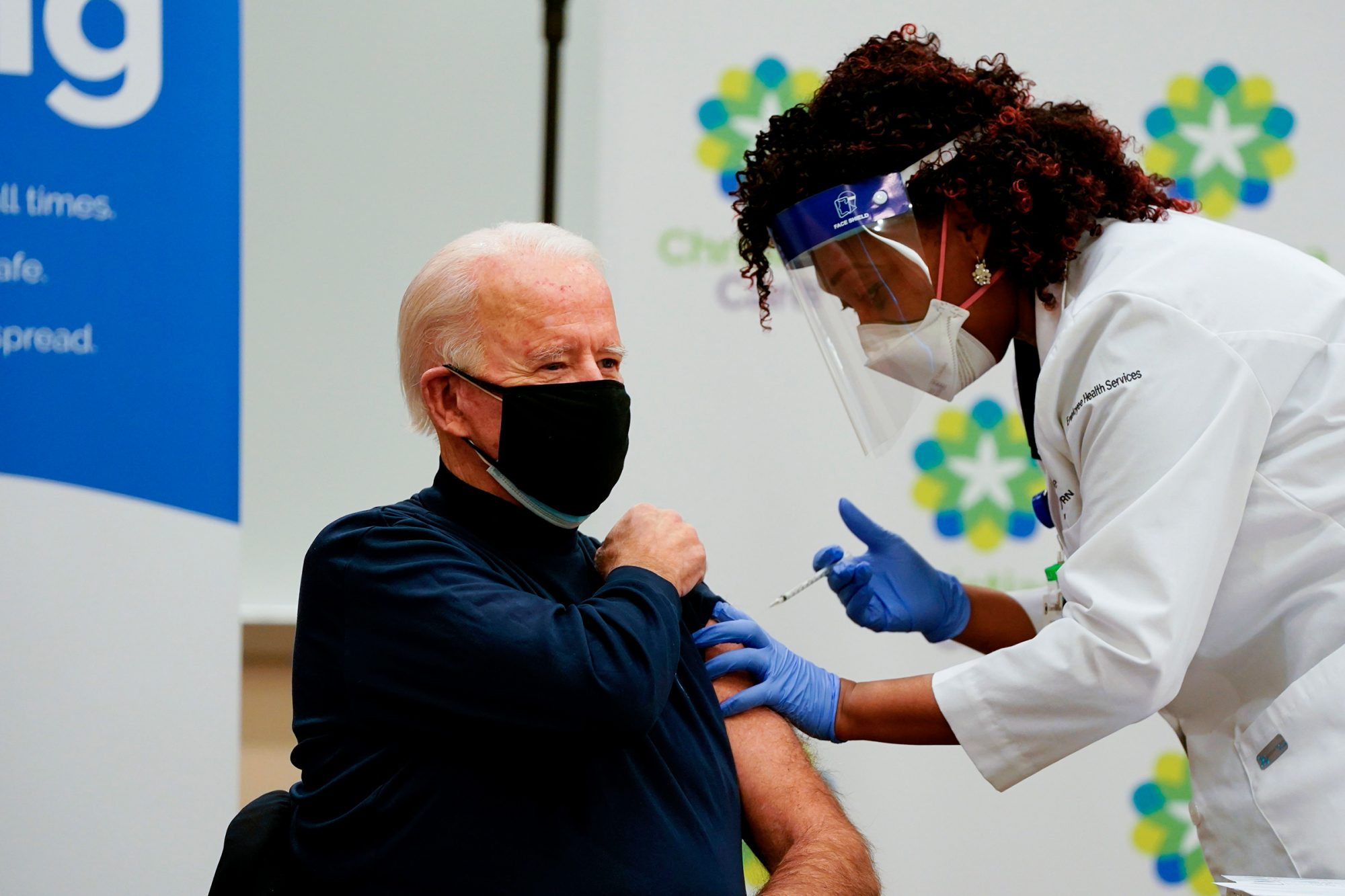 US President-elect Joe Biden receives a Covid-19 vaccination from Tabe Masa, Nurse Practitioner and Head of Employee Health Services, at the Christiana Care campus in Newark, Delaware