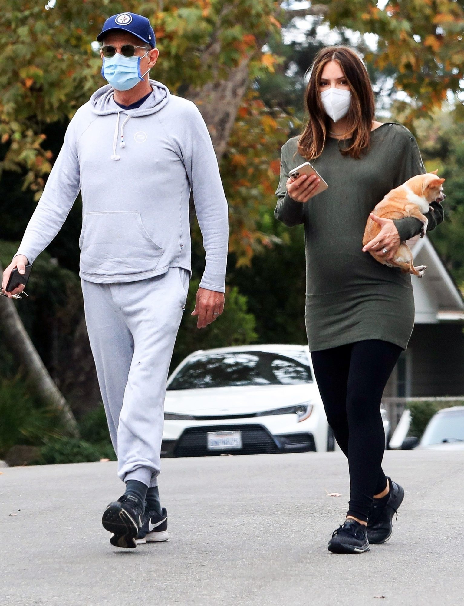 David Foster and his pregnant wife Katharine McPhee-Foster enjoy a morning stroll