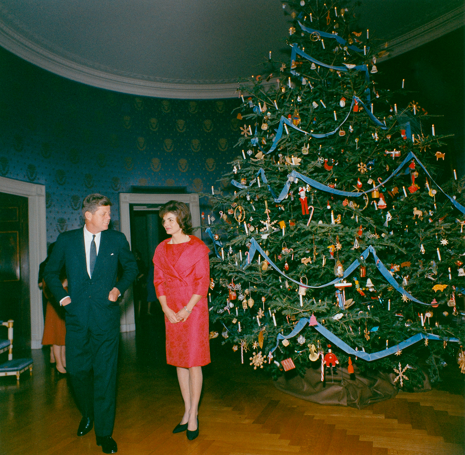 President John F. Kennedy and First Lady Jacqueline Kennedy in front of the Blue Room Christmas tree