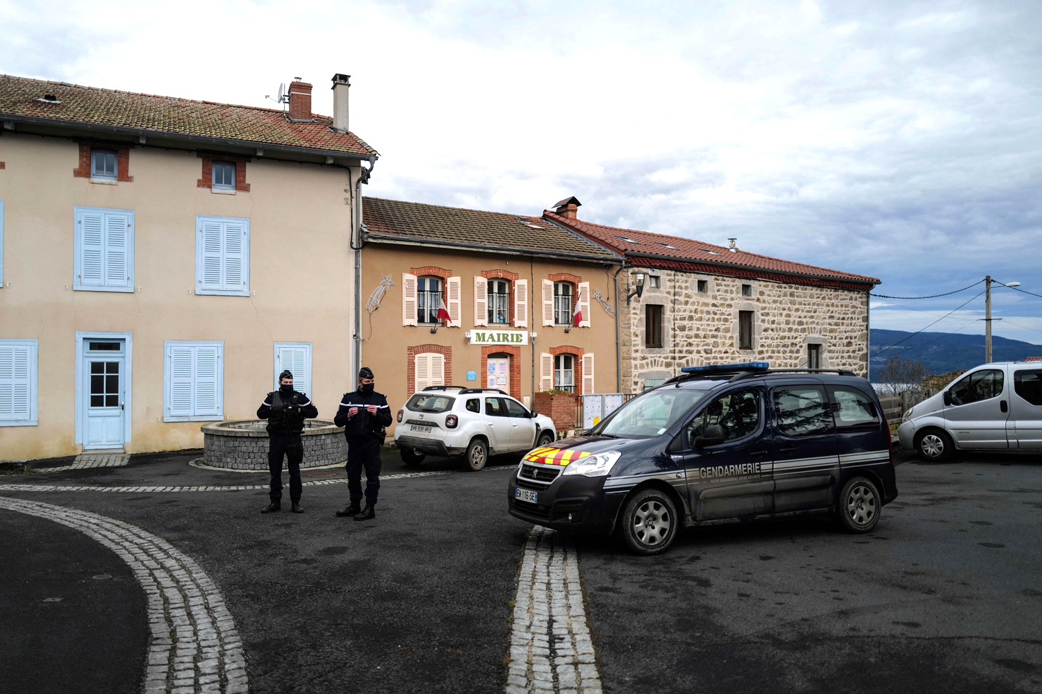 French Gendarmes stand in front of the city hall in Saint-Just