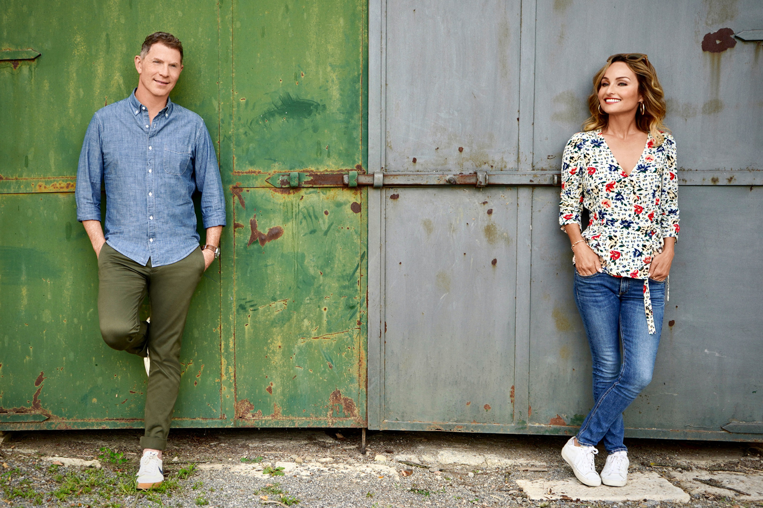 Bobby Flay and Giada De Laurentiis pose on the grounds of Tenuta Astrone in Tuscany