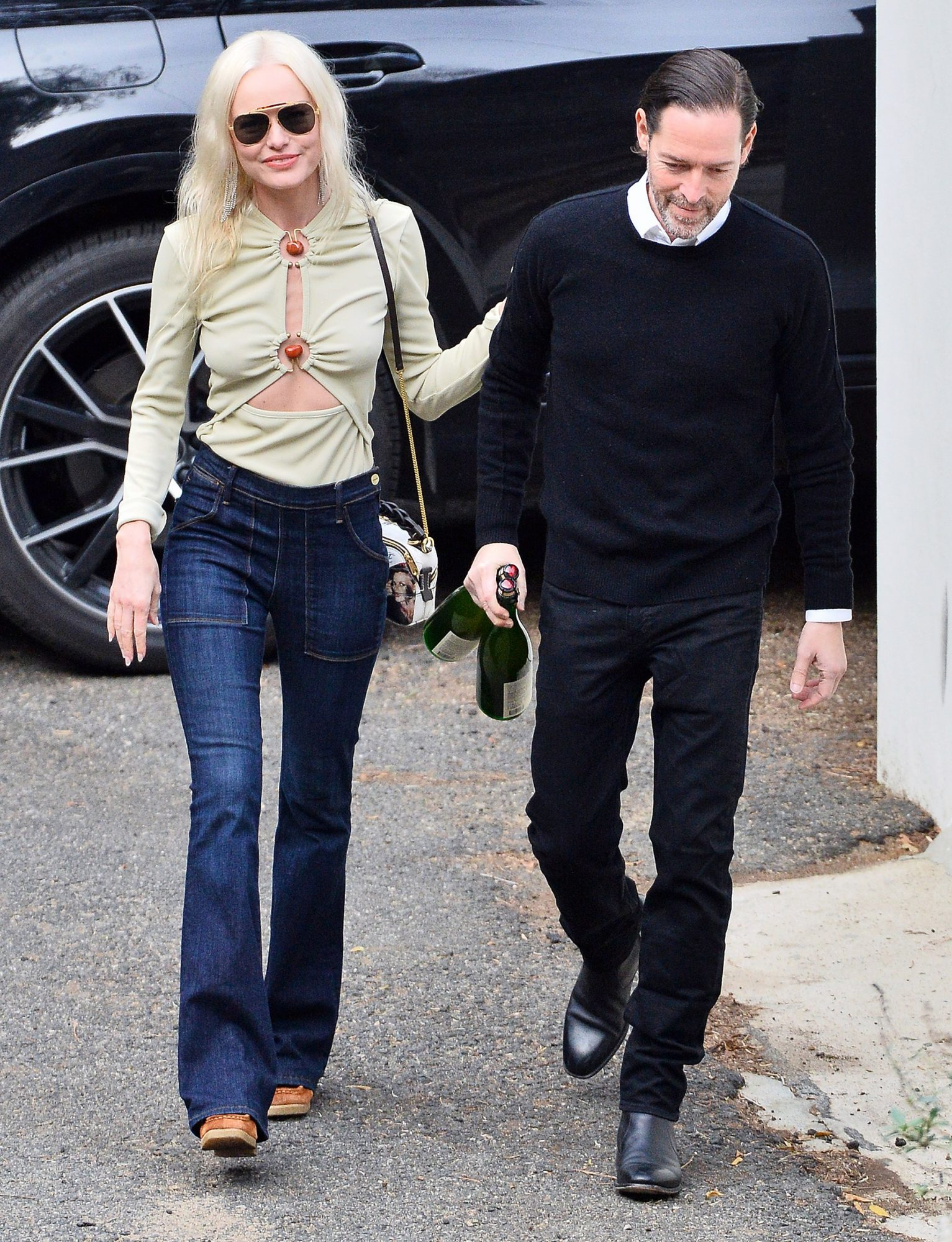 Kate Bosworth celebrates her 38th birthday with her husband Michael Polish as they head to a friend's house with a couple of bottles to celebrate
