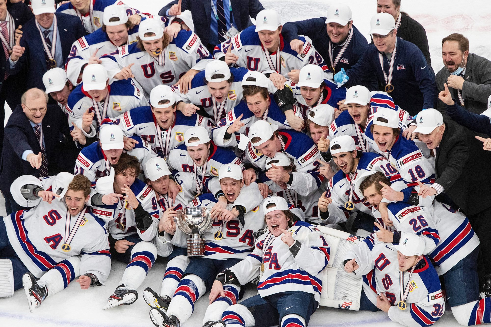 The U.S. team celebrates a win over Canada in the title game in the IIHF World Junior Hockey Championship, Tuesday, Jan. 5, 2021, in Edmonton, Alberta