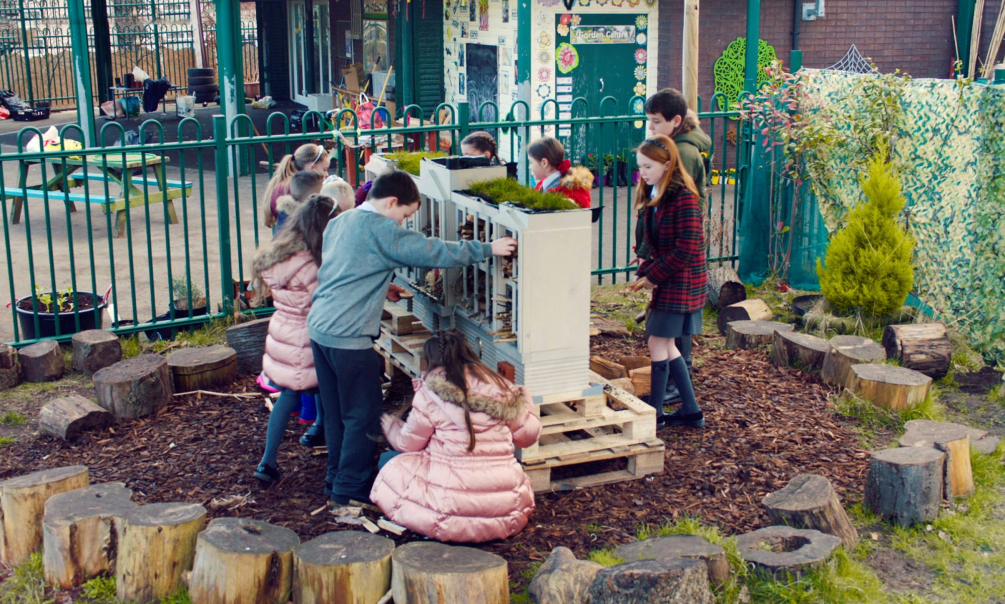 The Eco Emeralds with their giant bug hotel at All Saints Primary School in Anfield, Liverpool.