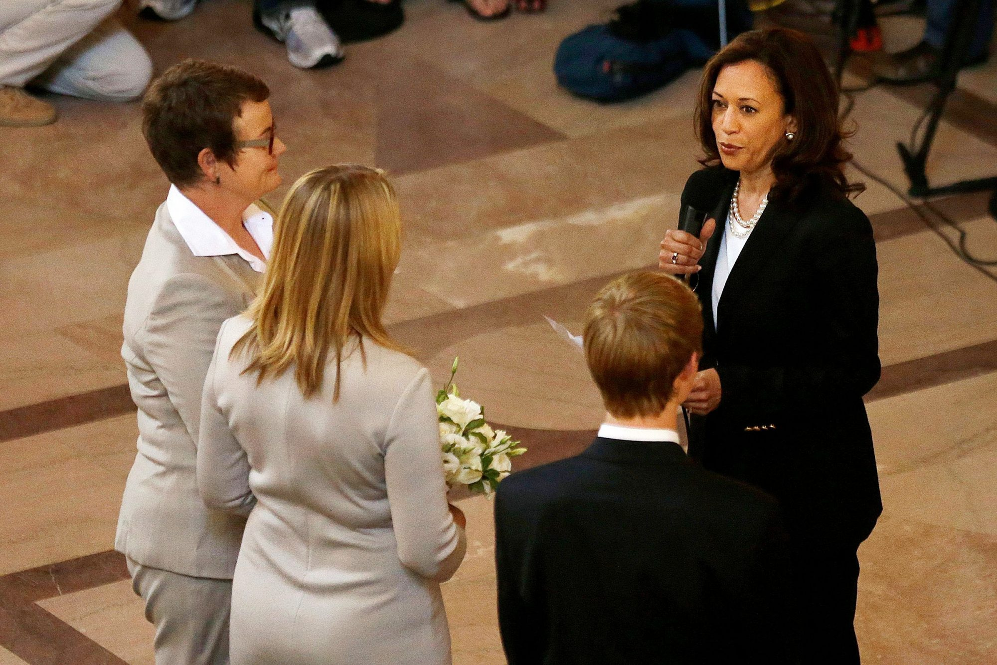 Attorney General Kamala Harris, right, officiates the wedding of Kris Perry, left, and Sandy Stier, second from left, in San Francisco, . Stier and Perry were married Friday, June 28, 2013