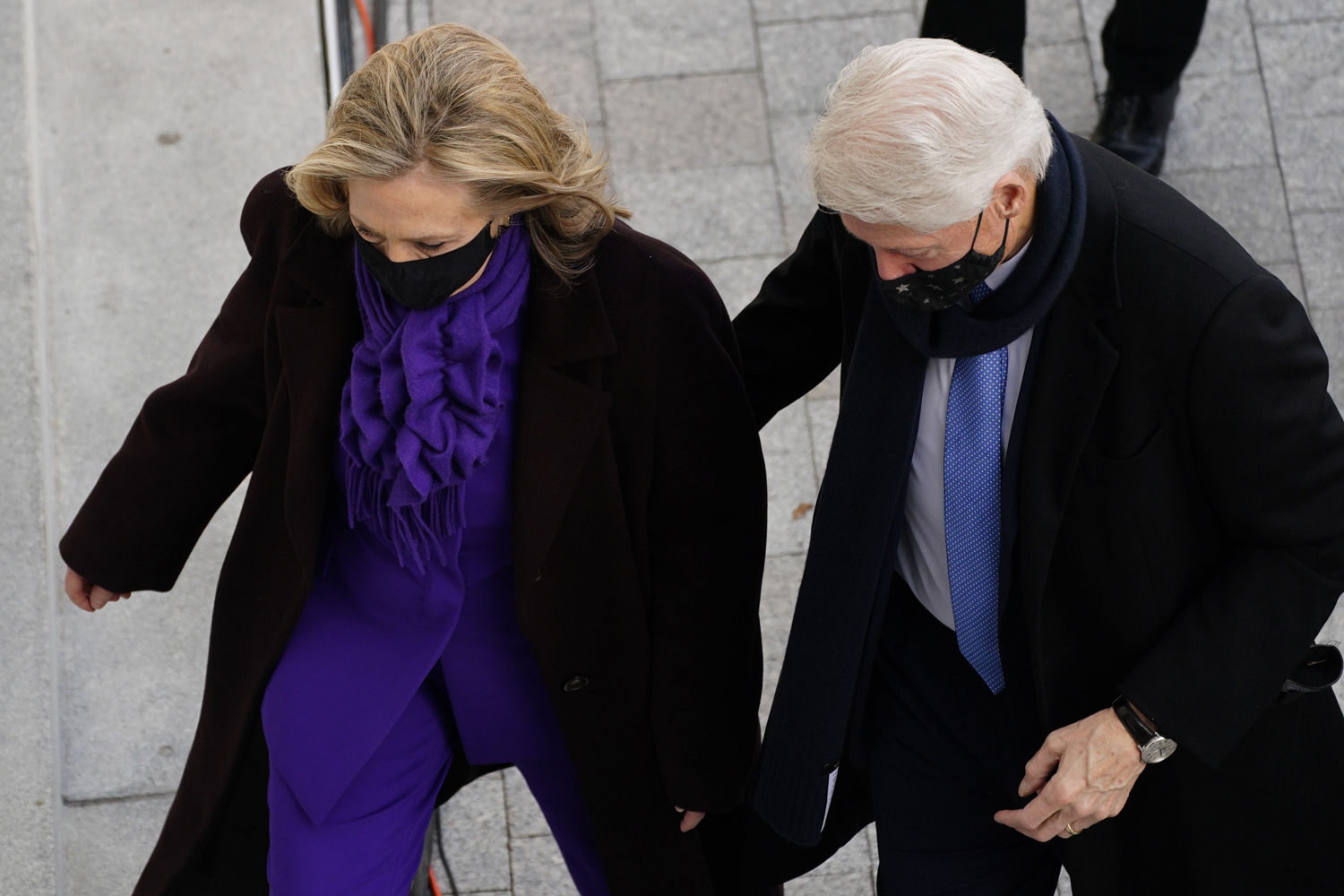 Former US First Lady and Secretary of State Hillary Clinton (L) and Former US President Bill Clinton (R) arrives for the inauguration of Joe Biden