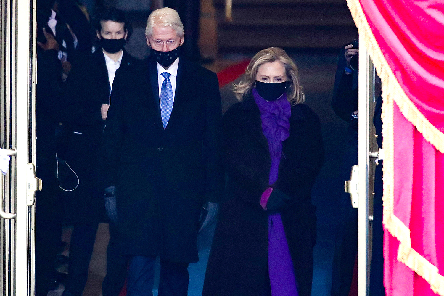 Former U.S. President Bill Clinton arrives with former Secretary of State Hillary Clinton to the inauguration of U.S. President-elect Joe Biden