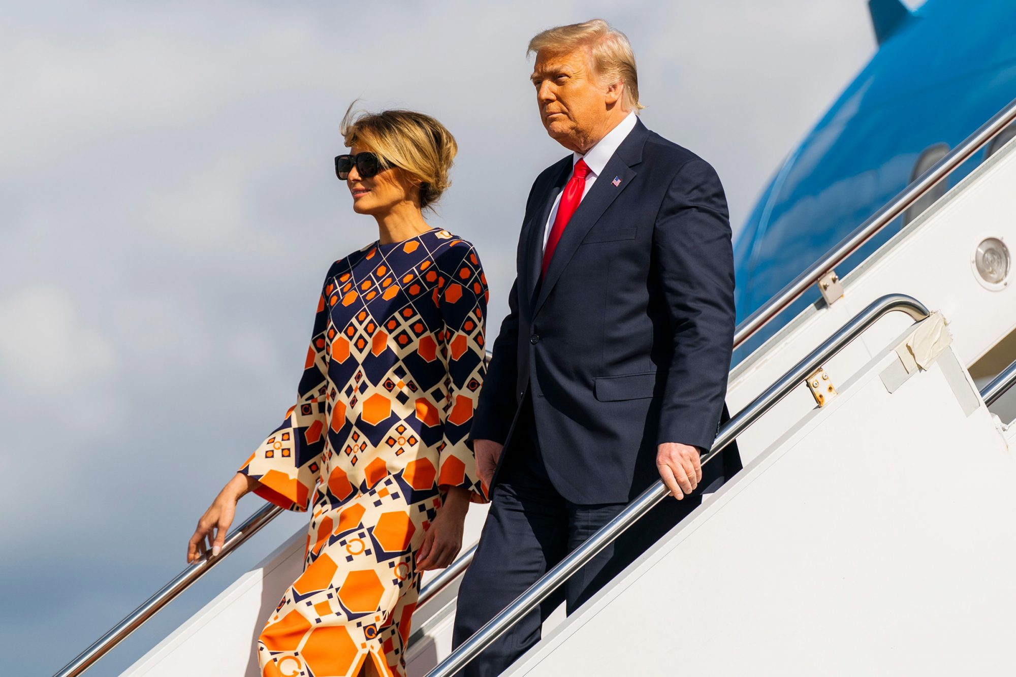 Former President Donald Trump and Melania Trump disembark from their final flight on Air Force One at Palm Beach International Airport in West Palm Beach, Fla Trump, West Palm Beach, United States - 20 Jan 2021