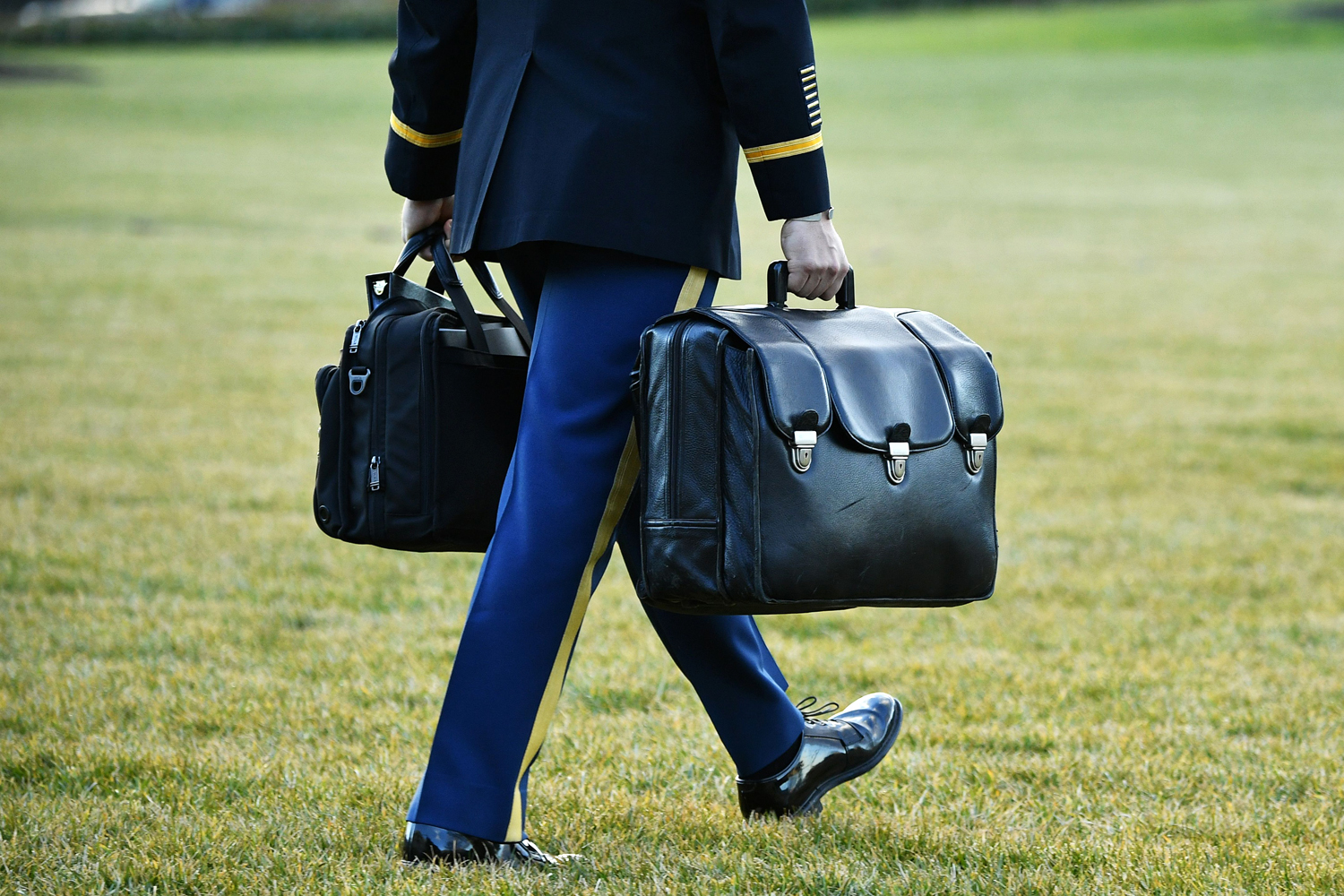 """A military aide carries the nuclear """"football"""" with the equipment and nuclear codes to Marine One"""