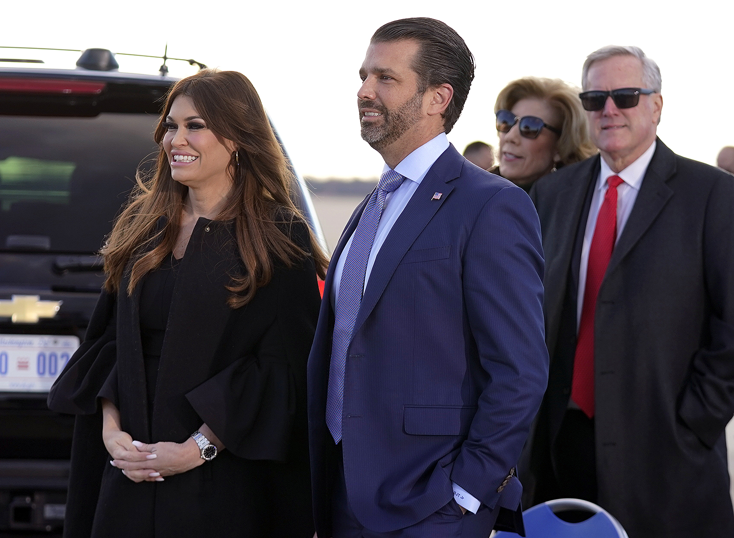 Donald Trump Jr., and his girlfriend Kimberly Guilfoyle, and White House chief of staff Mark Meadows wait for President Donald Trump and First Lady Melania Trump to arrive and board Air Force One for a final time at Andrews Air Force Base, Md Trump, Andrews Air Force Base, United States - 20 Jan 2021