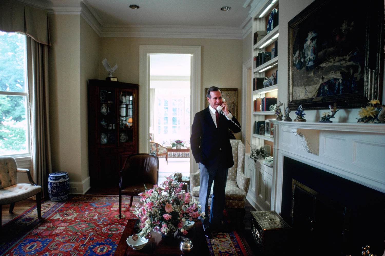 Vice President George H.W. Bush answers a phone call in the Vice President's Residence circa 1983