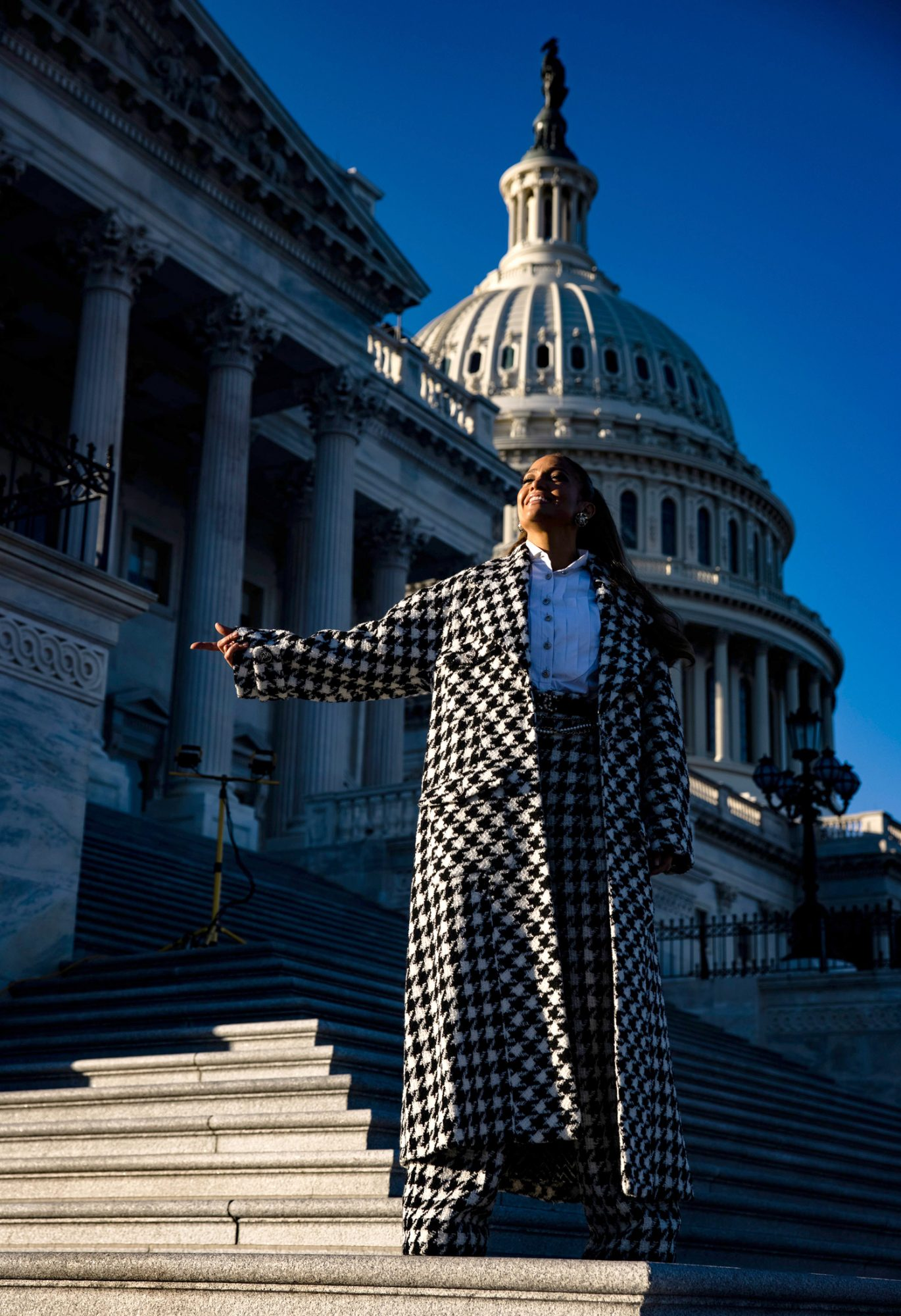 Jennifer Lopez poses on the steps to the House of Representatives