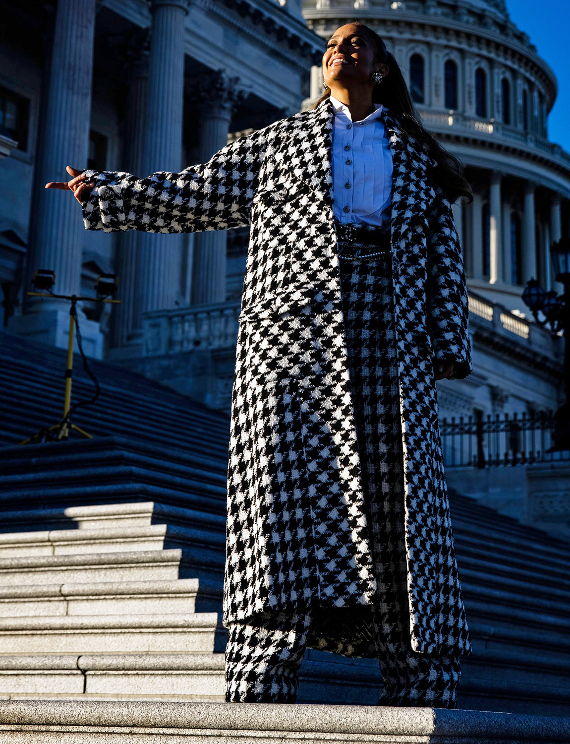 Singer and actress Jennifer Lopez poses on the steps to the House of Representatives with the US Capitol