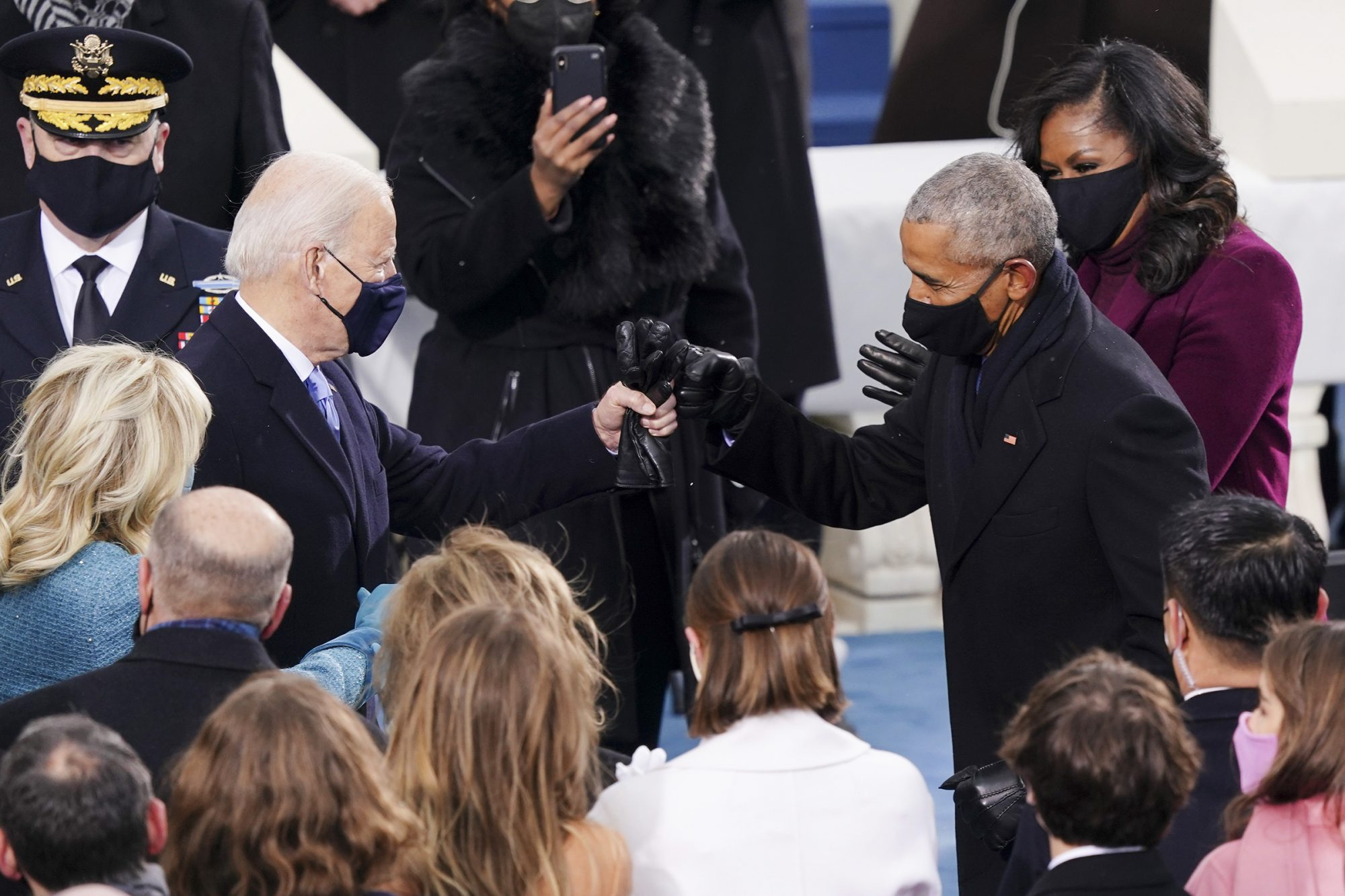 U.S. President-elect Joe Biden, left, greets former U.S. President Barack Obama, right, with a fist bump during the 59th presidential inauguration in Washington, D.C., U.S., on Wednesday, Jan. 20