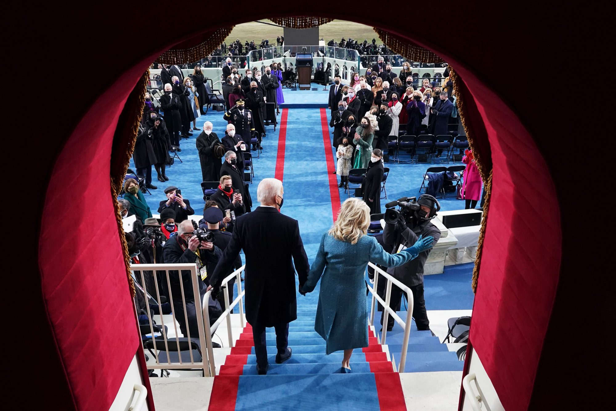 US President-elect Joe Biden (R) and incoming US First Lady Jill Biden arrive for his inauguration as the 46th US President, on the West Front of the US Capitol in Washington