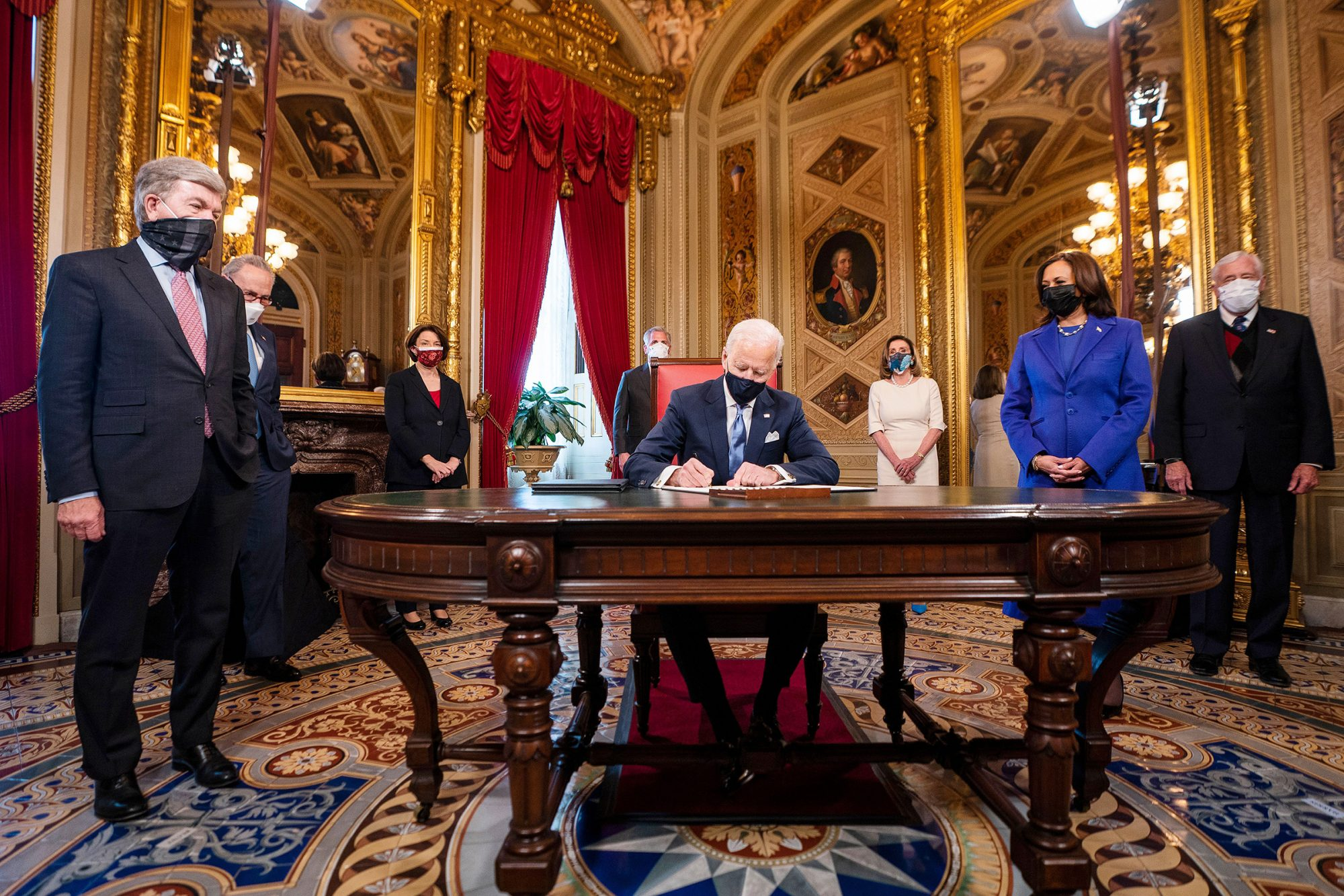President Joe Biden signs three documents including an inauguration declaration, cabinet nominations and sub-cabinet nominations in the President's Room at the US Capitol after the inauguration ceremony, at the U.S. Capitol in Washington