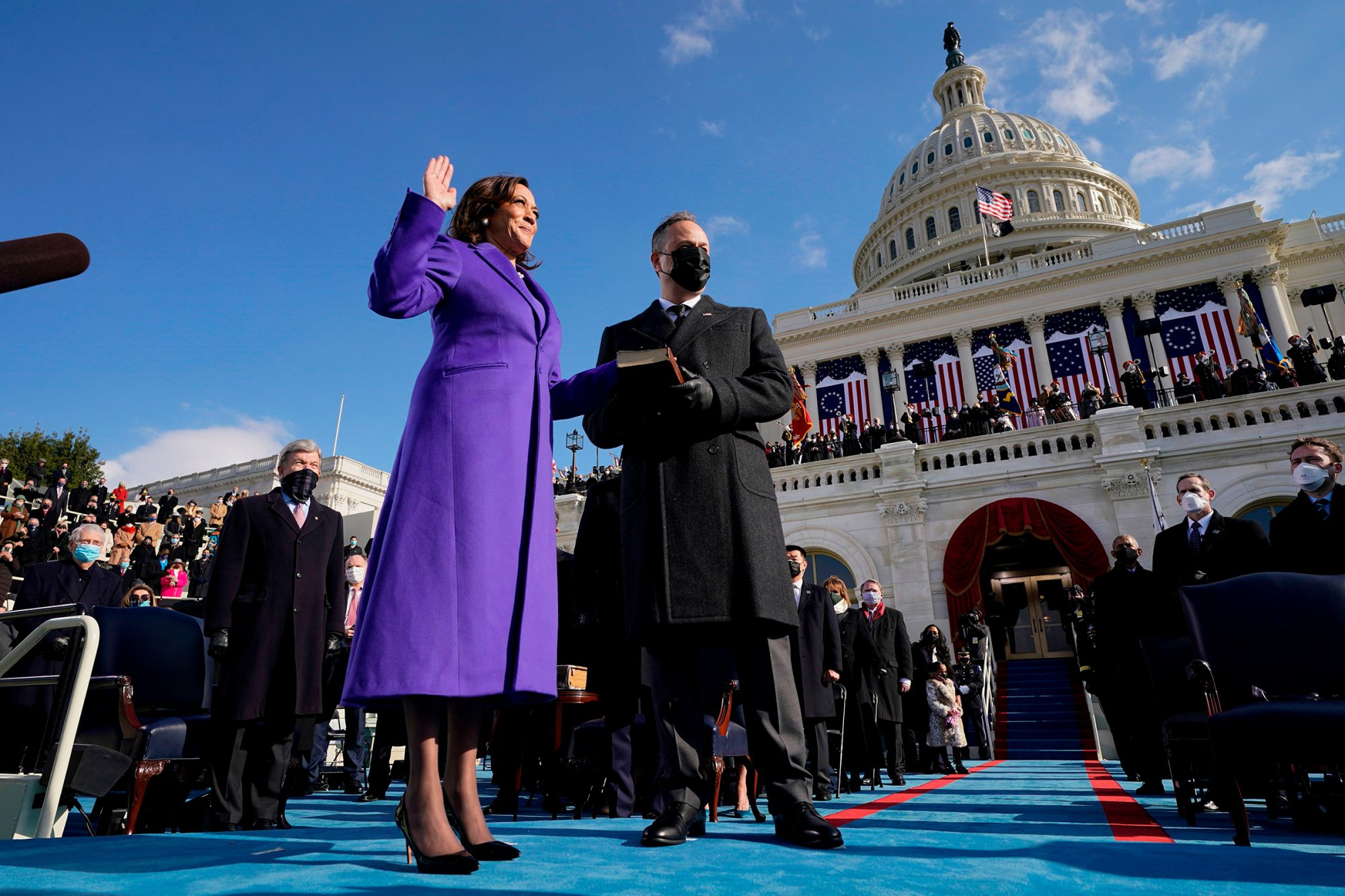 Kamala Harris (L), with her husband Second Gentleman Doug Emhoff, (C) is sworn in by Justice Sonia Sotomayor (R) as US President-elect Joe Biden look on as the 49th US Vice President by Supreme Court Justice Sonia Sotomayor on January 20, 2021