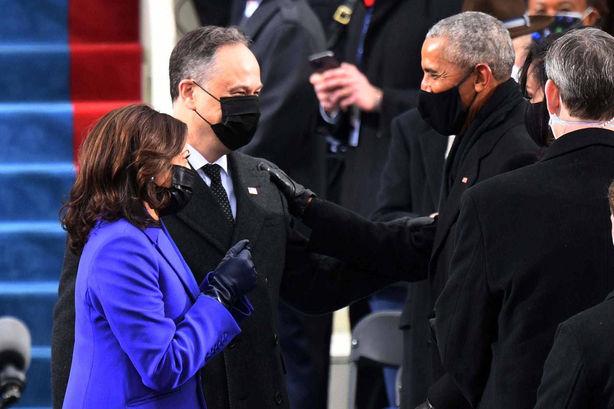 US Vice President-elect Kamala Harris (L) and incoming Second Gentleman Doug Emhoff speak with Former US President Barack Obama as they arrive for the inauguration of Joe Biden as the 46th US President on January 20, 2021