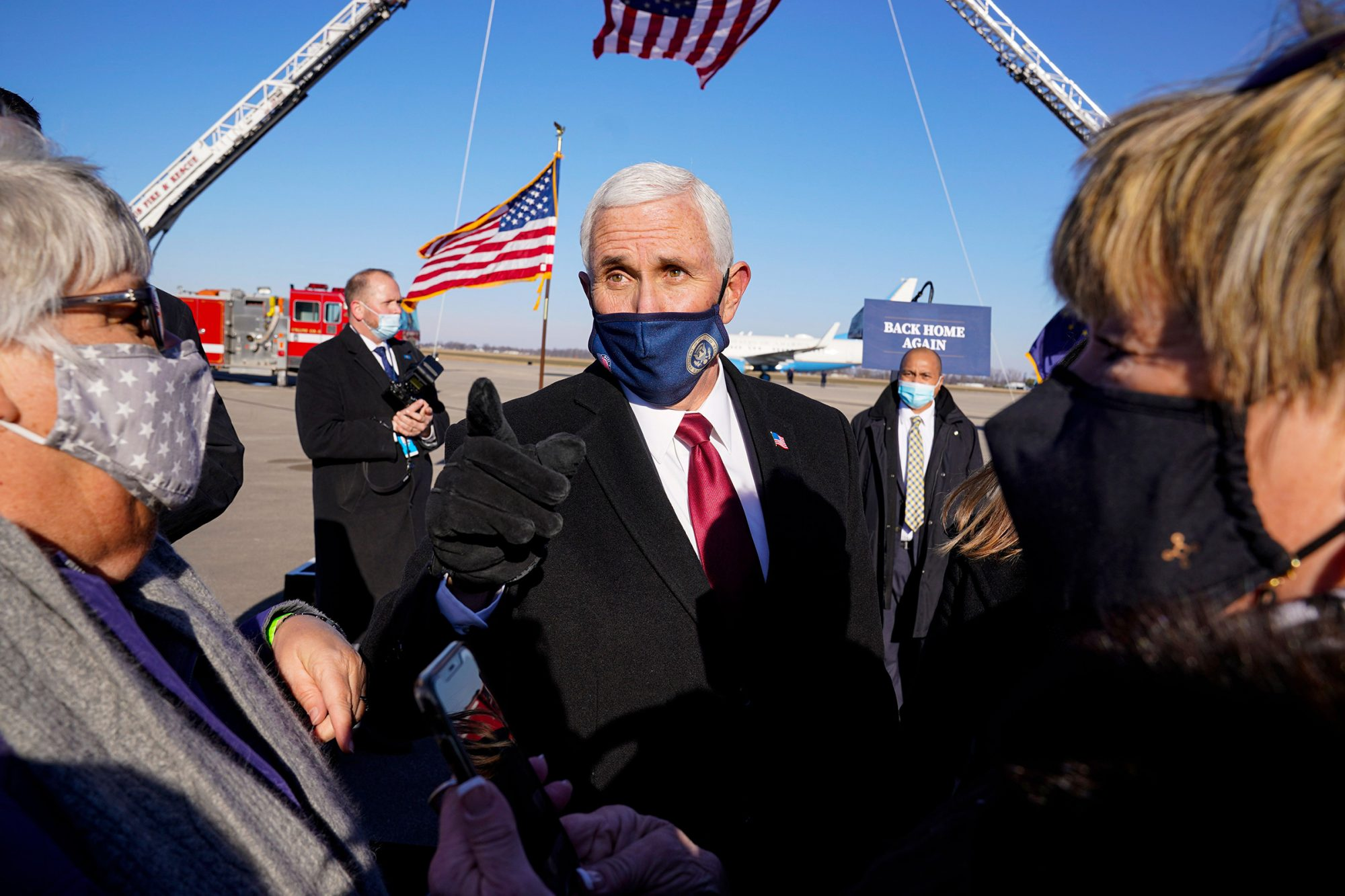 Former Vice President Mike Pence greets supporters after arriving back in his hometown of Columbus, Ind
