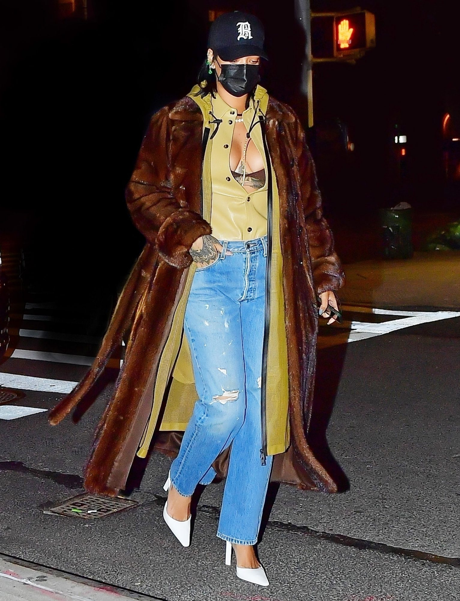 Rihanna shows ample cleavage stepping out for a dinner date with A$AP Rocky in NYC