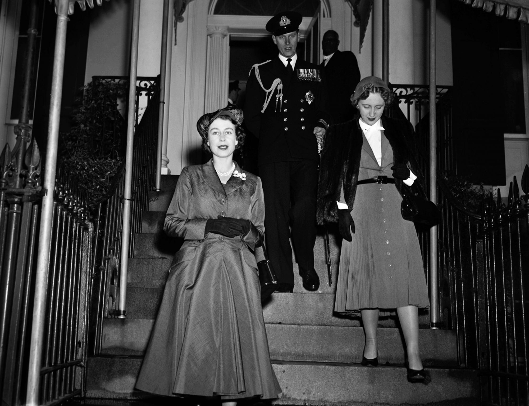 Britain's Princess Elizabeth leads the Duke of Edinburgh and Miss Margaret Truman, daughter of the president, Harry Truman, as they leave Blair House, for Mount Vernon in Virginia