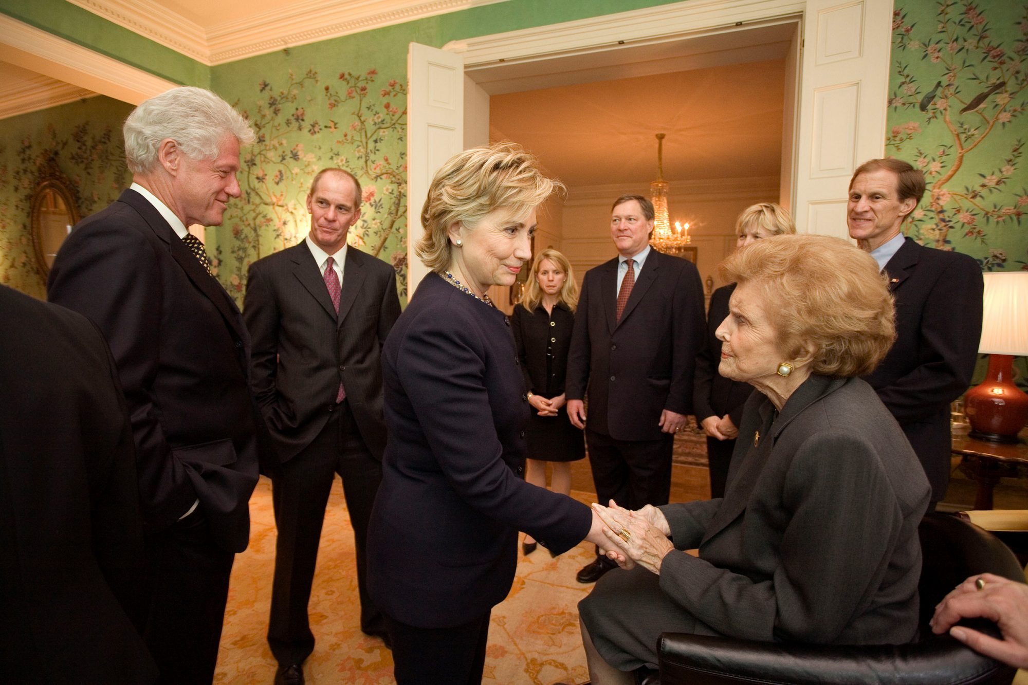 Former First Lady Betty Ford greets Sen. Hillary Clinton and former President Bill Clinton at the Blair House on January 1, 2007 in Washington, DC