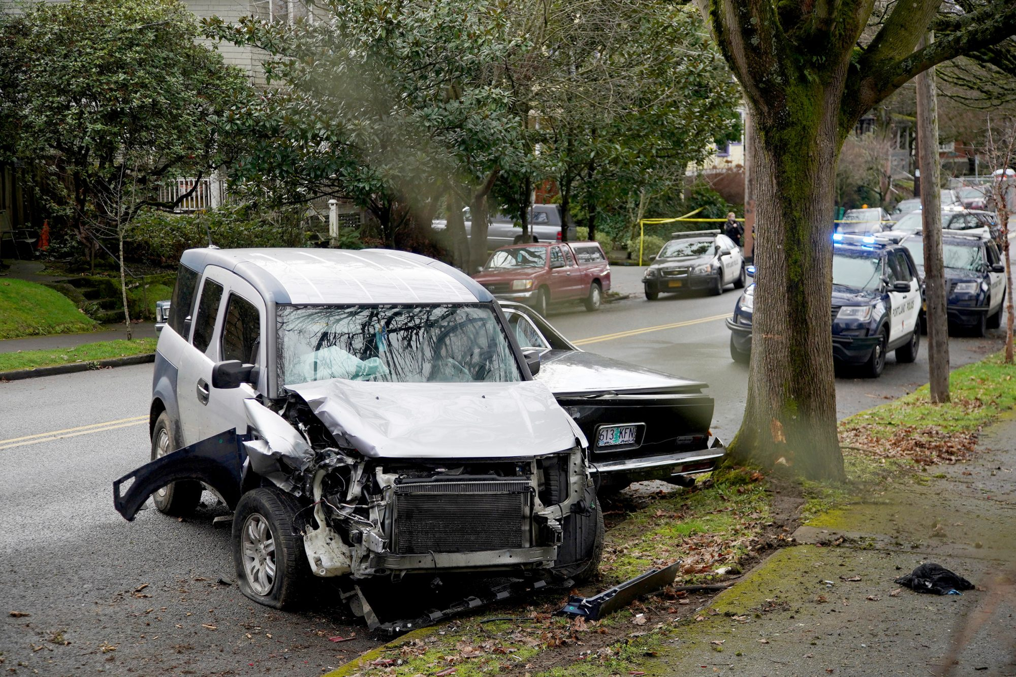 A wrecked vehicle is seen after a driver struck and injured at least five people over a 20-block stretch of Southeast Portland, Ore.