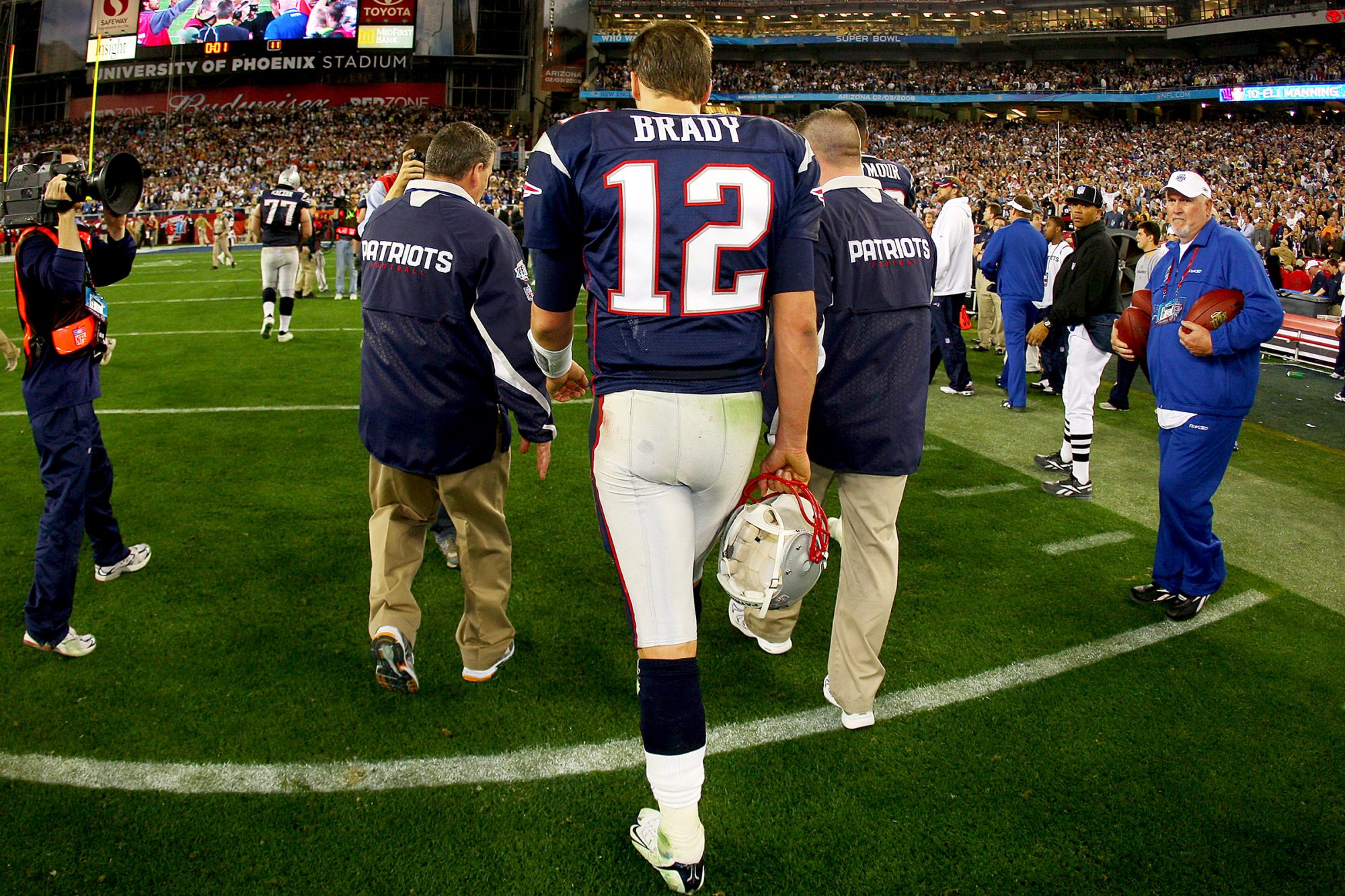 Tom Brady #12 of the New England Patriots walks off the field after losing to the New York Giants 17-14 during Super Bowl XLII on February 3, 2008 at the University of Phoenix Stadium in Glendale