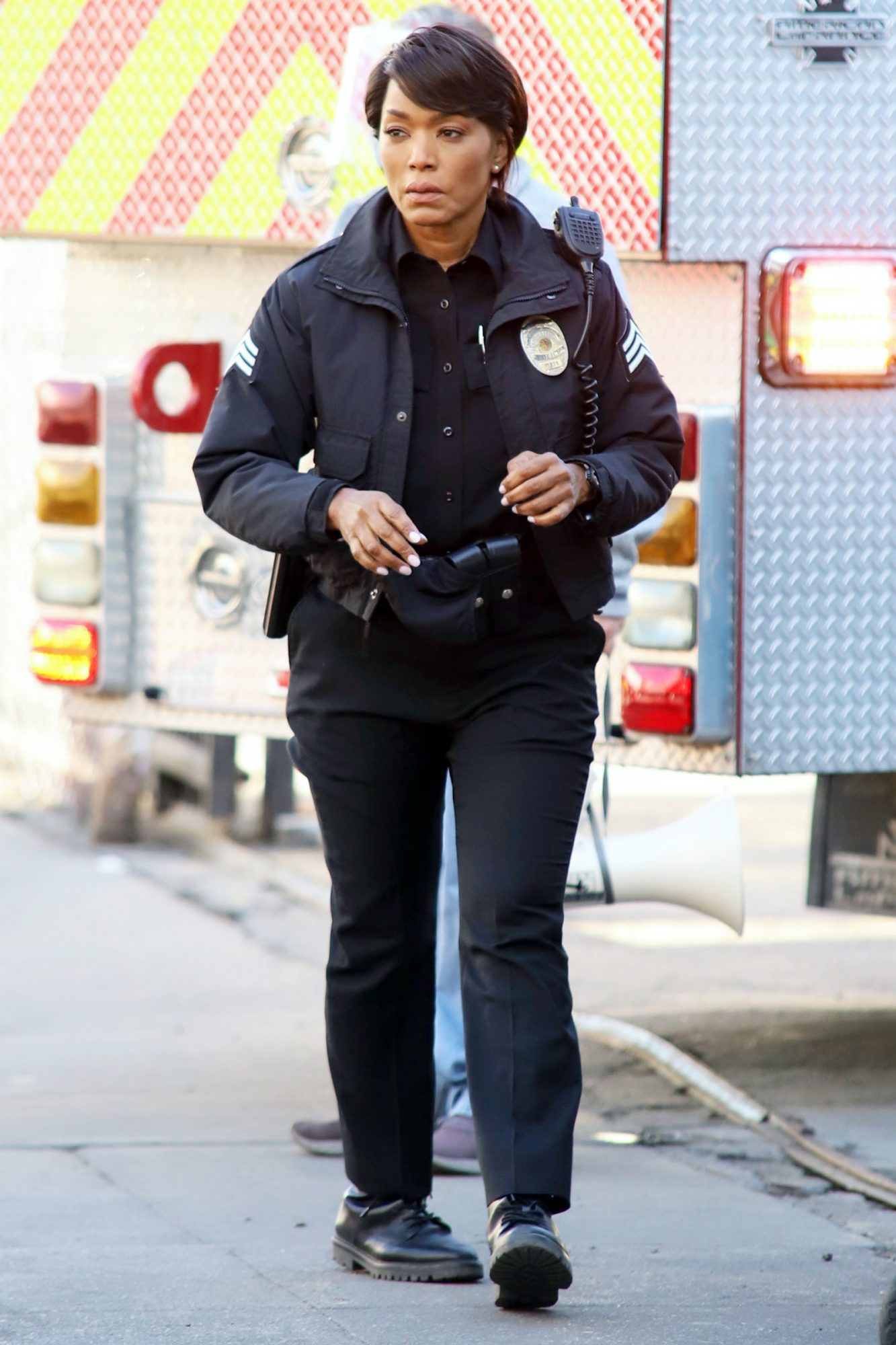 Angela Bassett on scene as a police officer for production of series Rescue 9-1-1