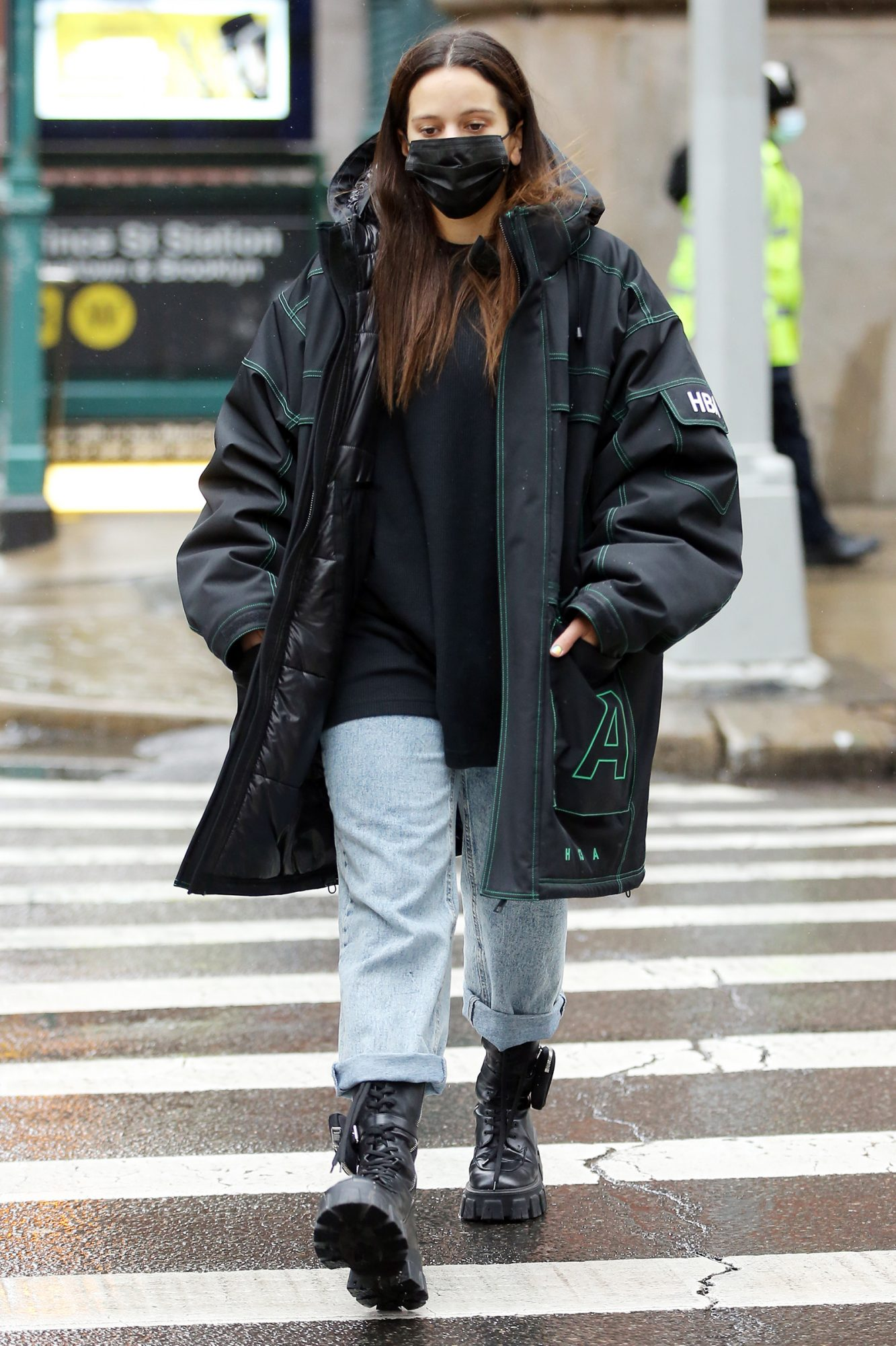 Spanish singer Rosalia is seen wearing a Hood By Air coat and chunky boots in Soho in New York City