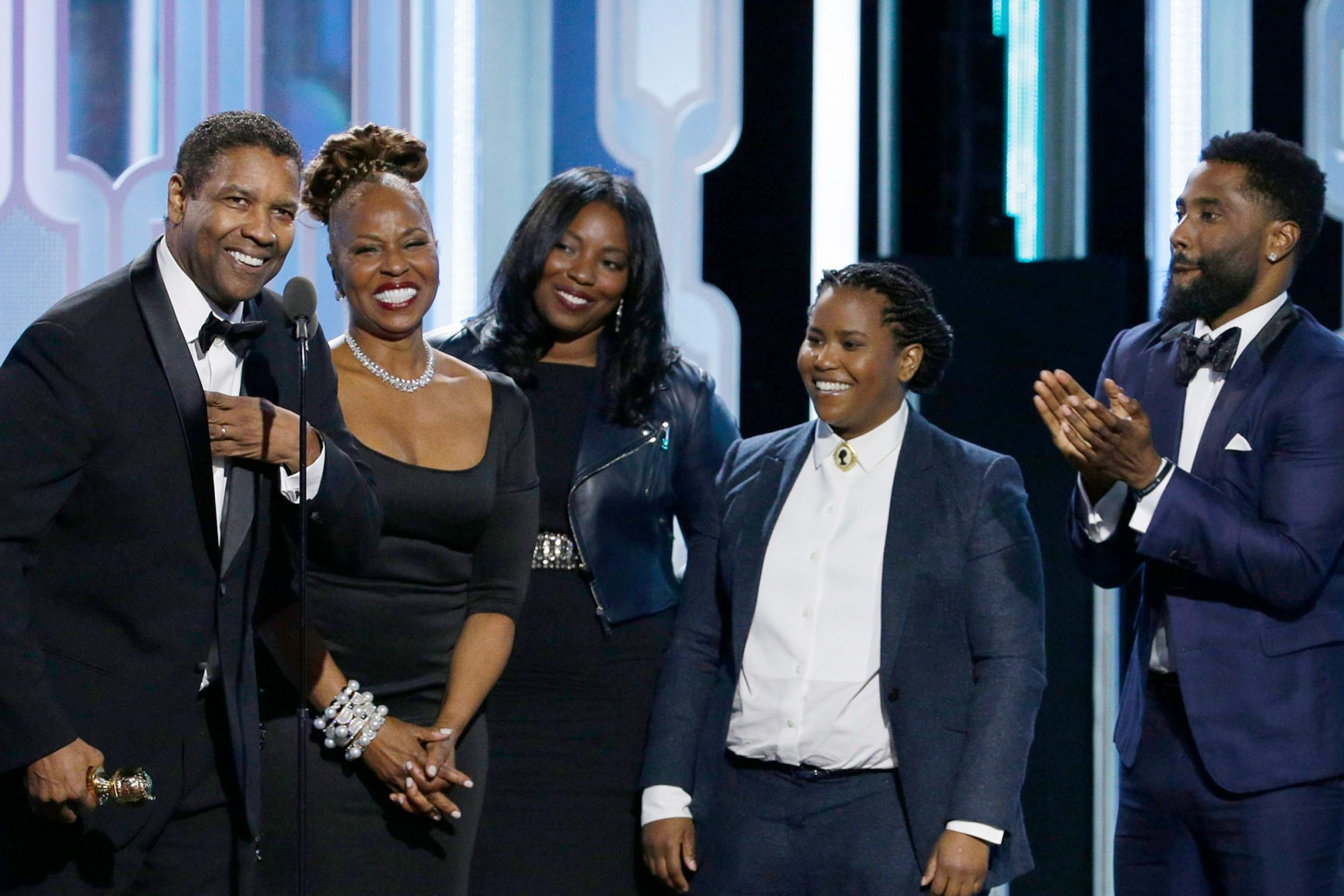 Denzel Washington accepts with Cecil B. Demille Award with his family during the 73rd Annual Golden Globe Awards at The Beverly Hilton Hotel on January 10, 2016 in Beverly Hills, California